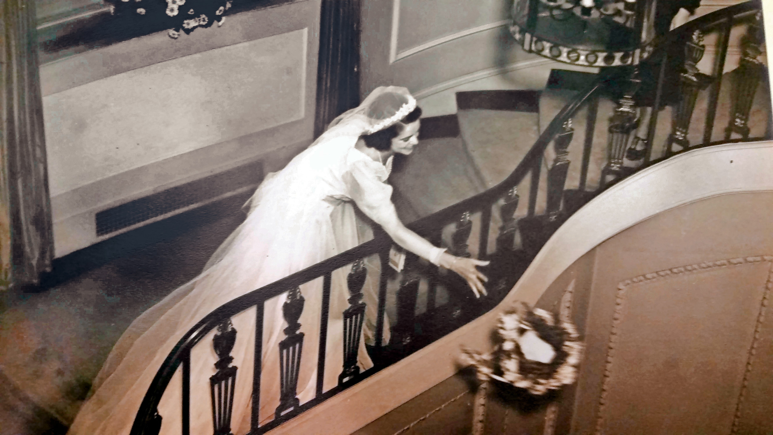Eleanor Miller-Carmody, Berens' mother, throwing her bouquet over the banister at the illustrious Norwich House mansion in 1937 during her wedding.