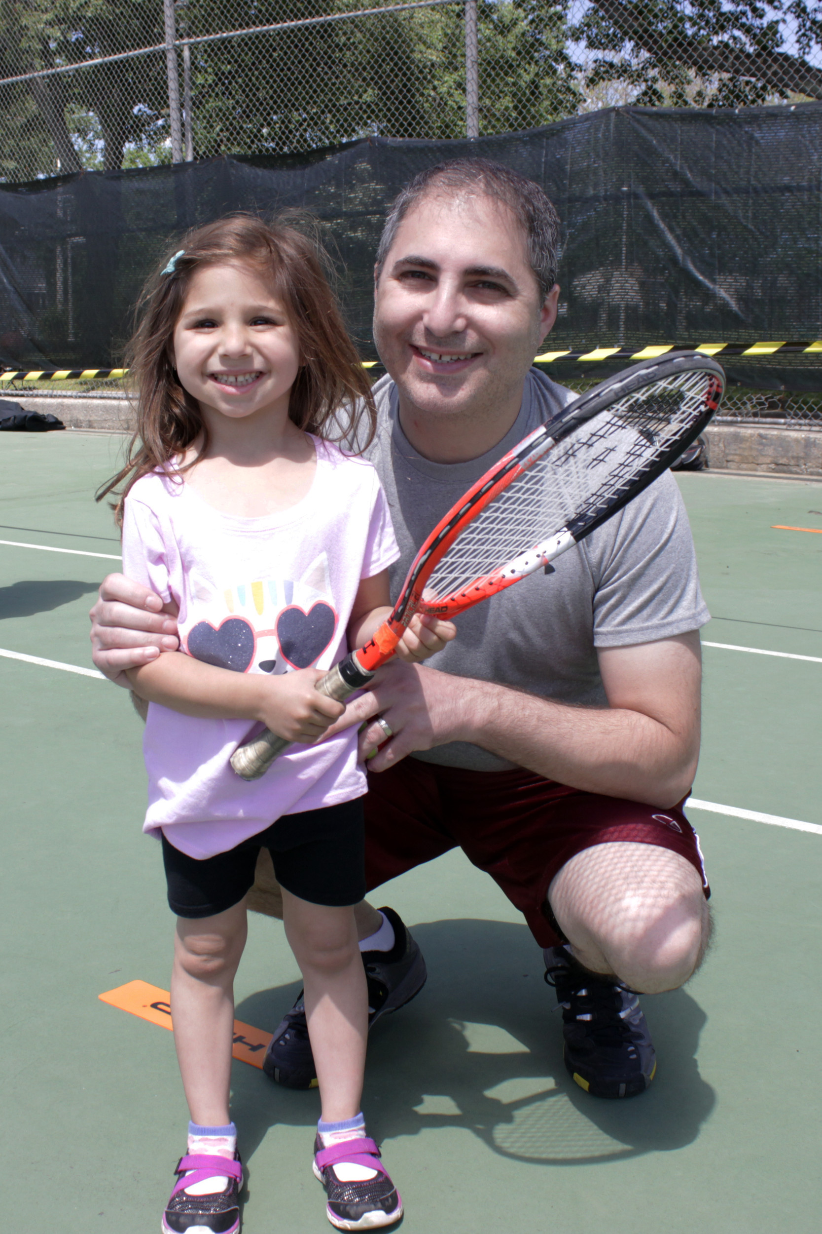 Gustavo That, of Valley Stream, attended the clinic to teach his daughter Gabriella, 4, how to play his favorite sport.