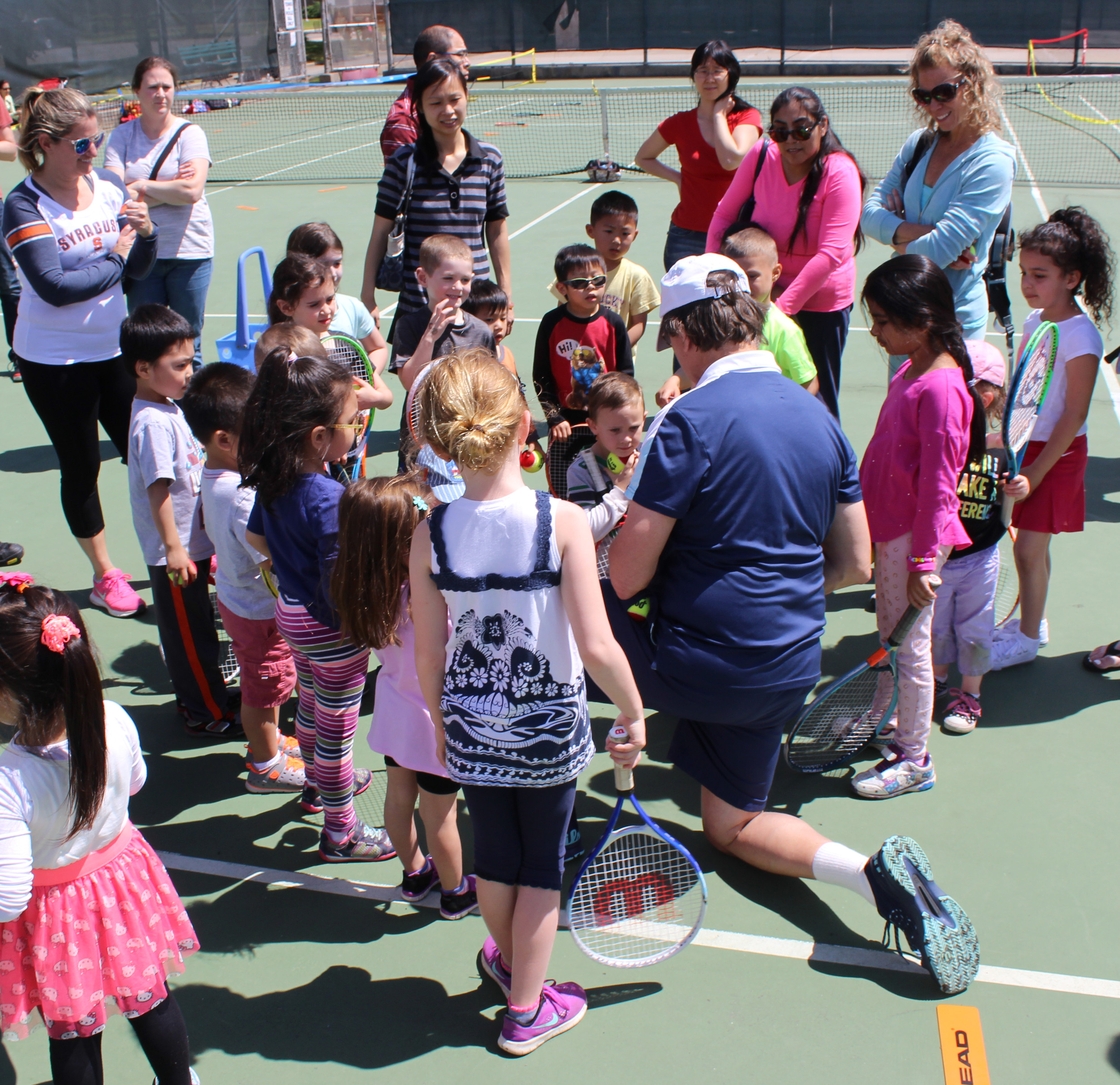 Tennis instructor Steve Abbondondelo addressed a crowd of children, ages 4-5, to teach them about tennis.