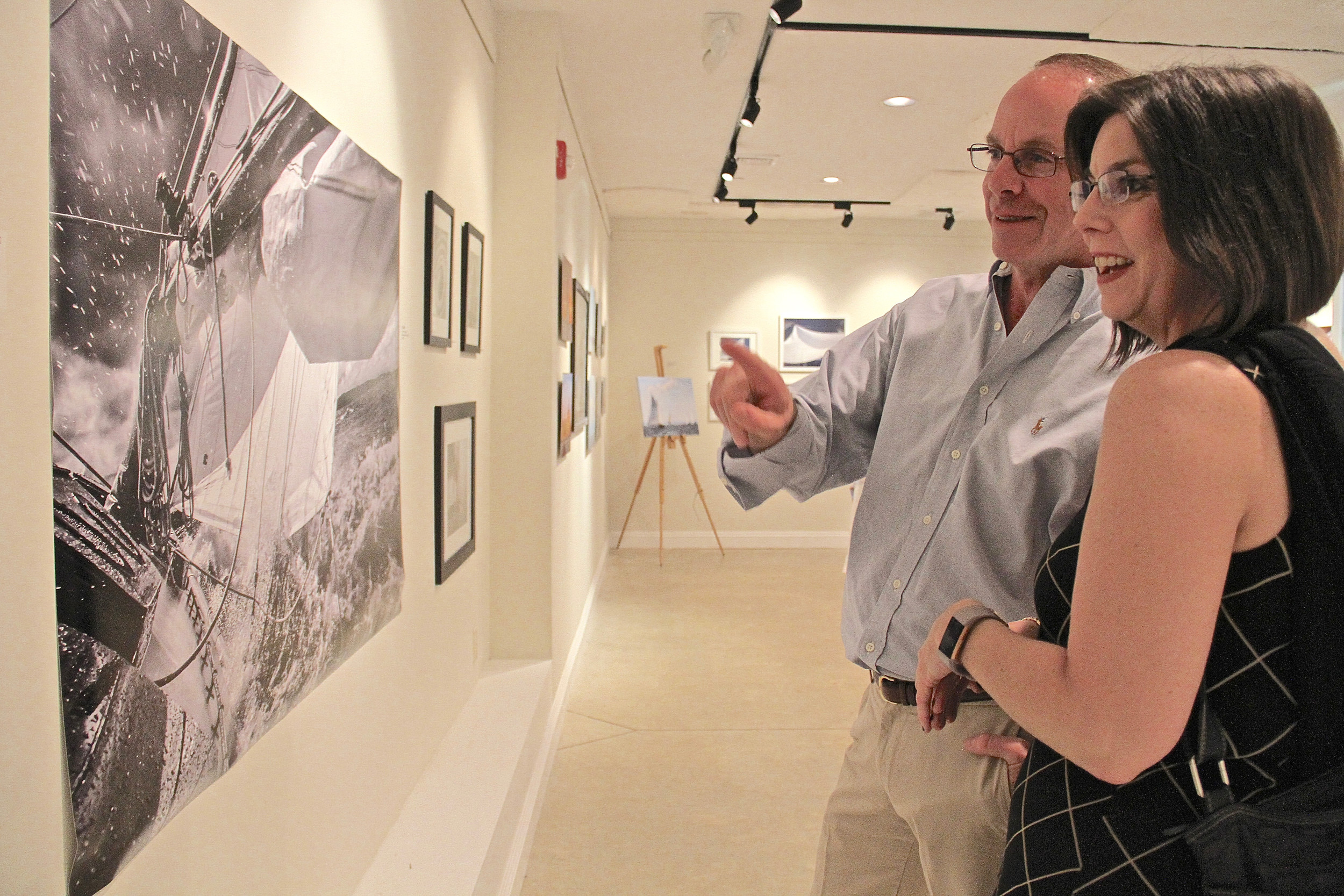 Alexandra Carton and Dale Morisco admired the photographs at Yana's opening reception held on May 19.