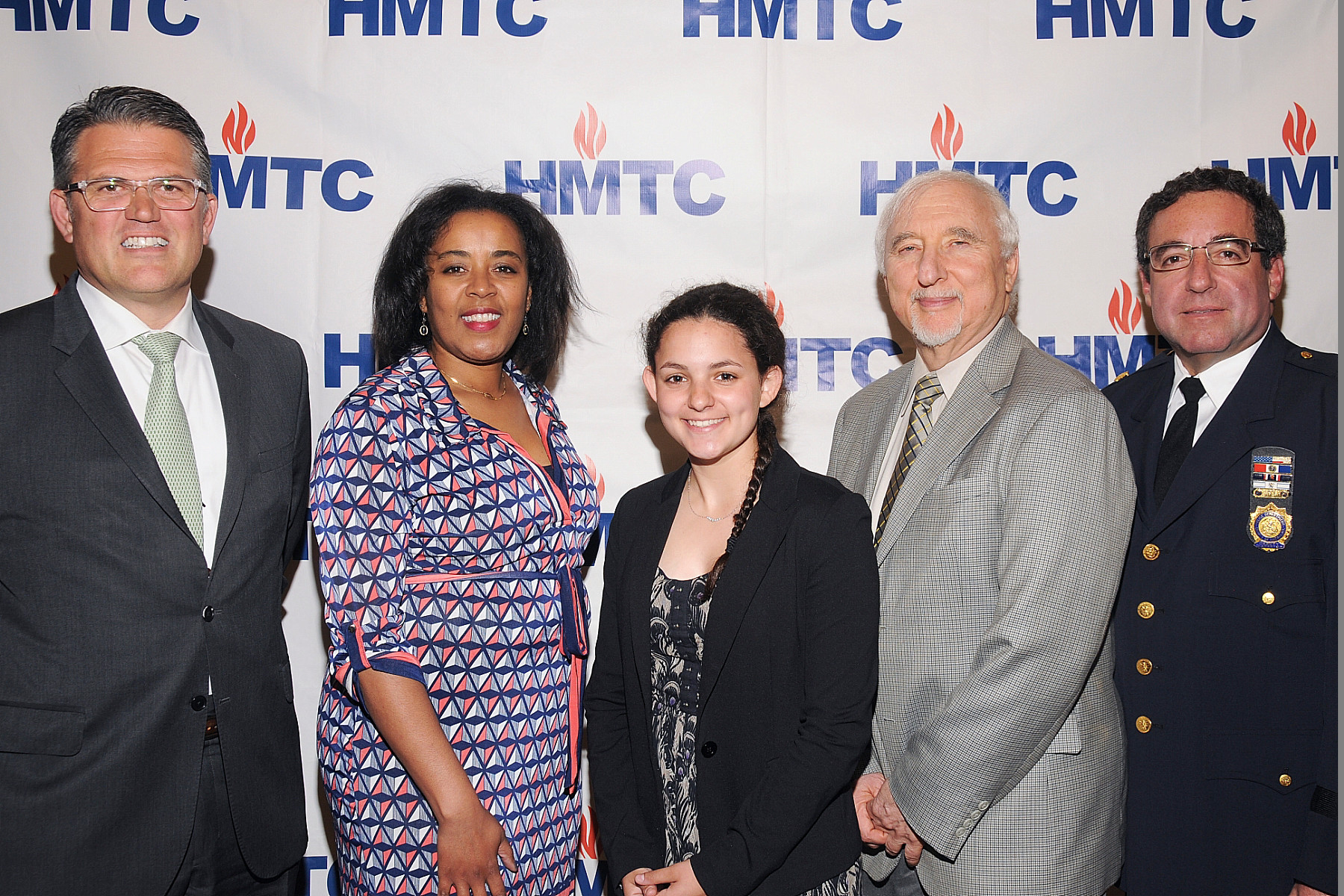 Hewlett High sophomore Sophie Riegel won an Upstander Award from the Holocaust Memorial & Tolerance Center of Nassau County. From left were Peter Klein, Claire Friedlander Family Foundation, Tracy Garrison-Feinberg, director of the Claire Friedlander Education Institute; Riegel, Steven Markowitz, chairman of the HTMC; and NCPD Deputy Inspector Alan Hirsch.