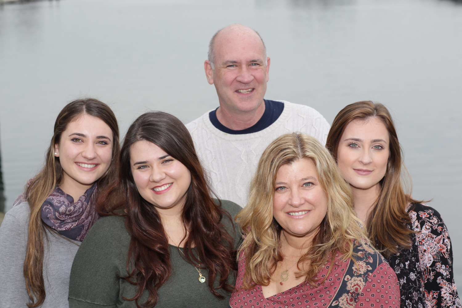 Richie Woods with his wife Wendy and daughters Julia, left, Justine and Jaime. The three loved having their father teach at the same high school they attended, Wendy said.