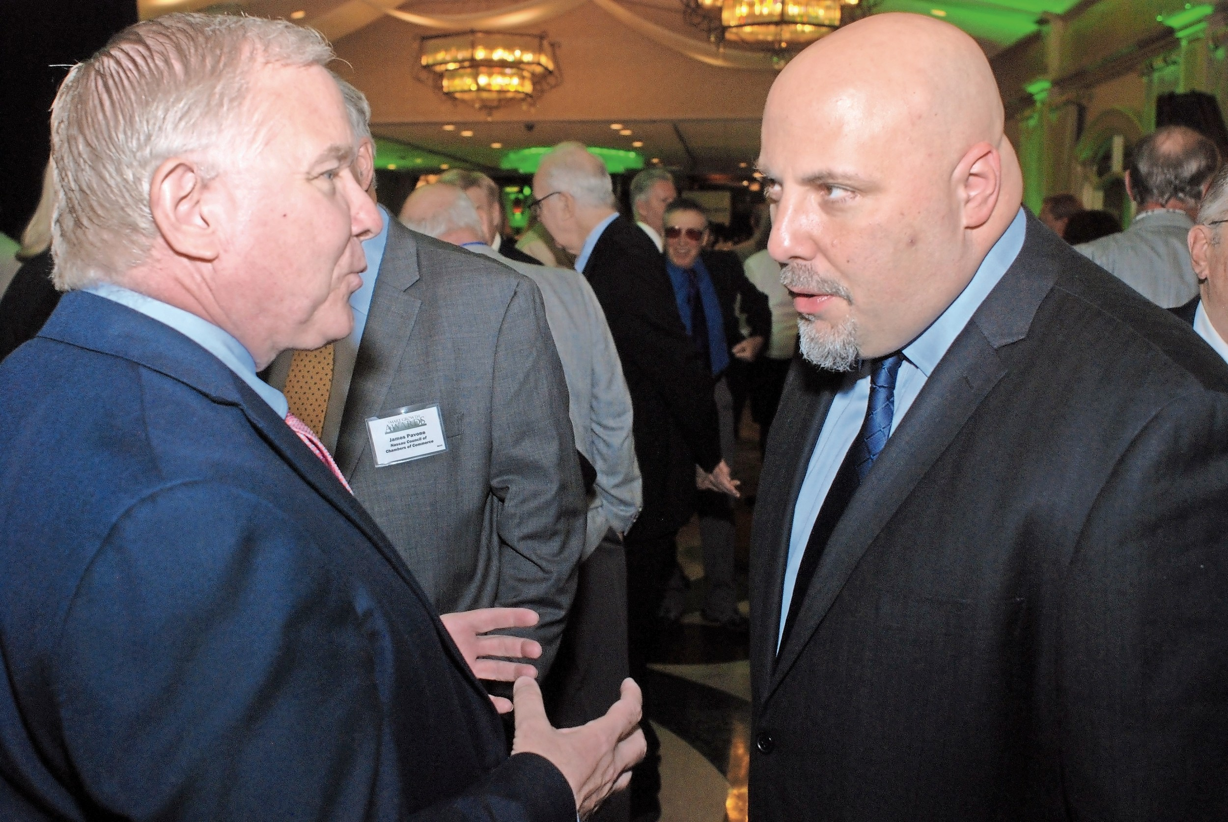 Former Village of Freeport Trustee Don Miller, left, chatted with Vision Long Island Director Eric Alexander.