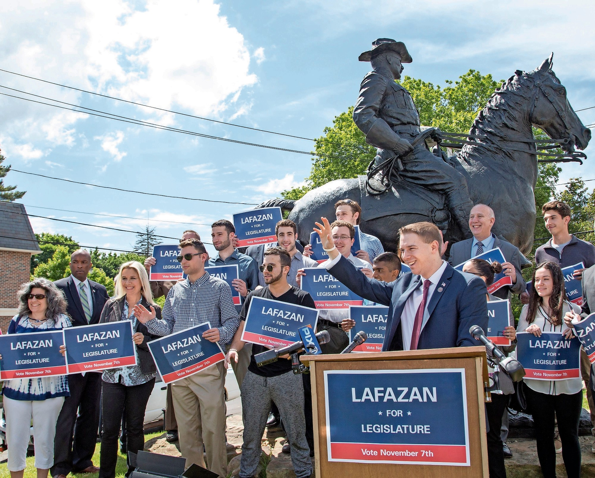 Joshua Lafazan announced his candidacy for legislator in front of the bronze Theodore Roosevelt statue in Oyster Bay.