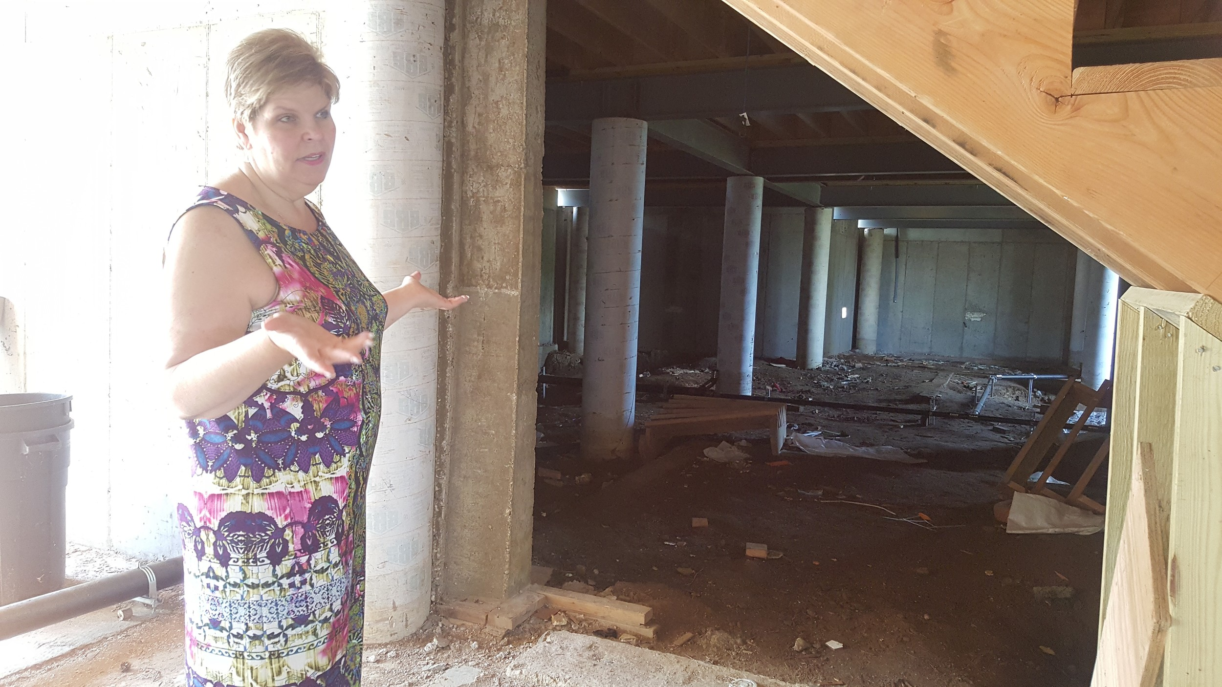 Freeport resident Ilona Jagnow stood in her mother's abandoned house, five years after SuperStorm Sandy ravaged Freeport. Jagnow has struggled with faulty contractors who have delayed the construction on the home.