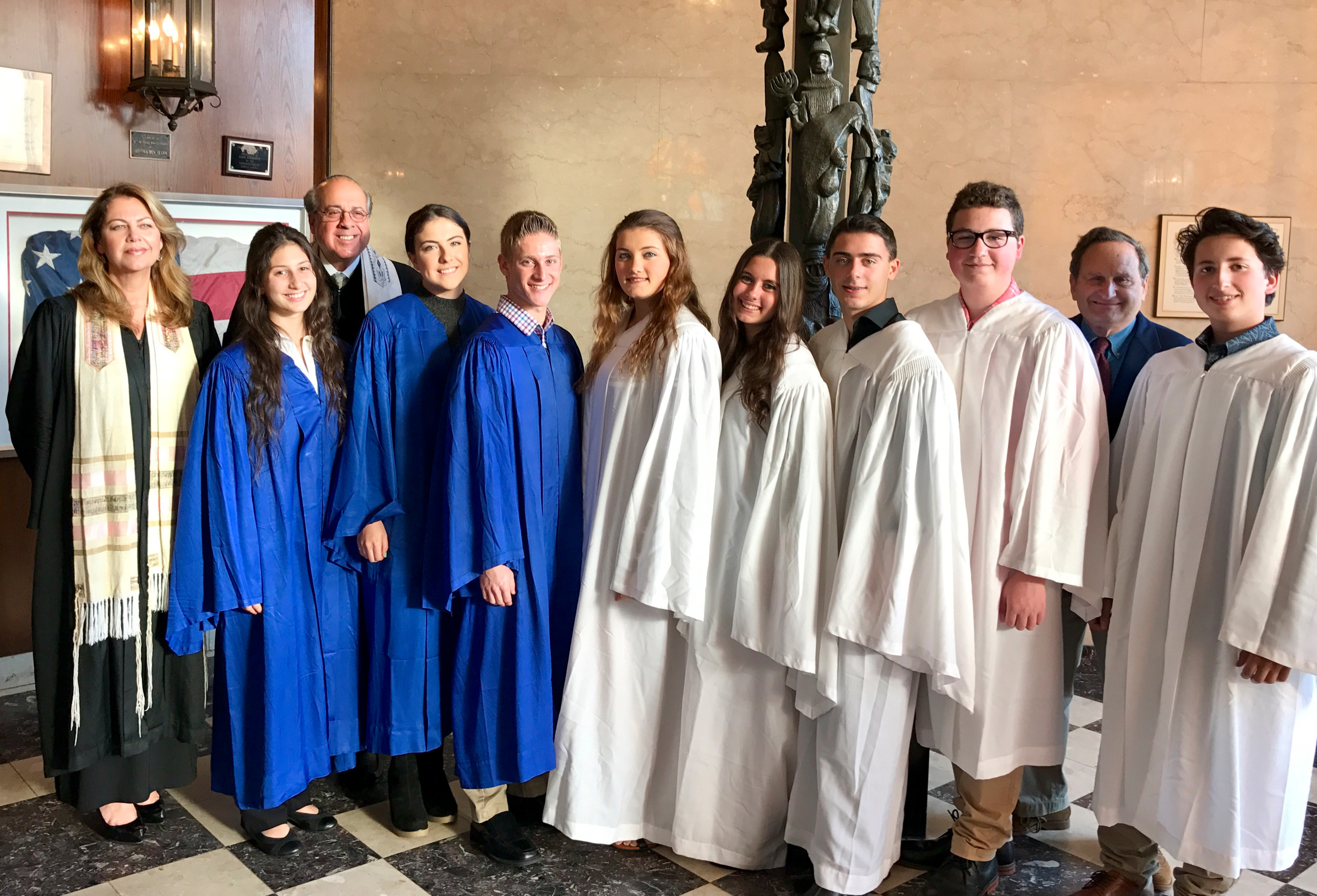 Religious school students from Temple Israel of Lawrence were conformed and graduated on May 31. From left were cantor Galina Makaveyev, Hannah Prusack, Rabbi Jay Rosenbaum, Sarah Nersesov, Sam Bodner, Hailee Elias, Madison Cosentino, Joseph Cosentino, David Clarke, temple President Kenneth Shapiro and Ben Simens.