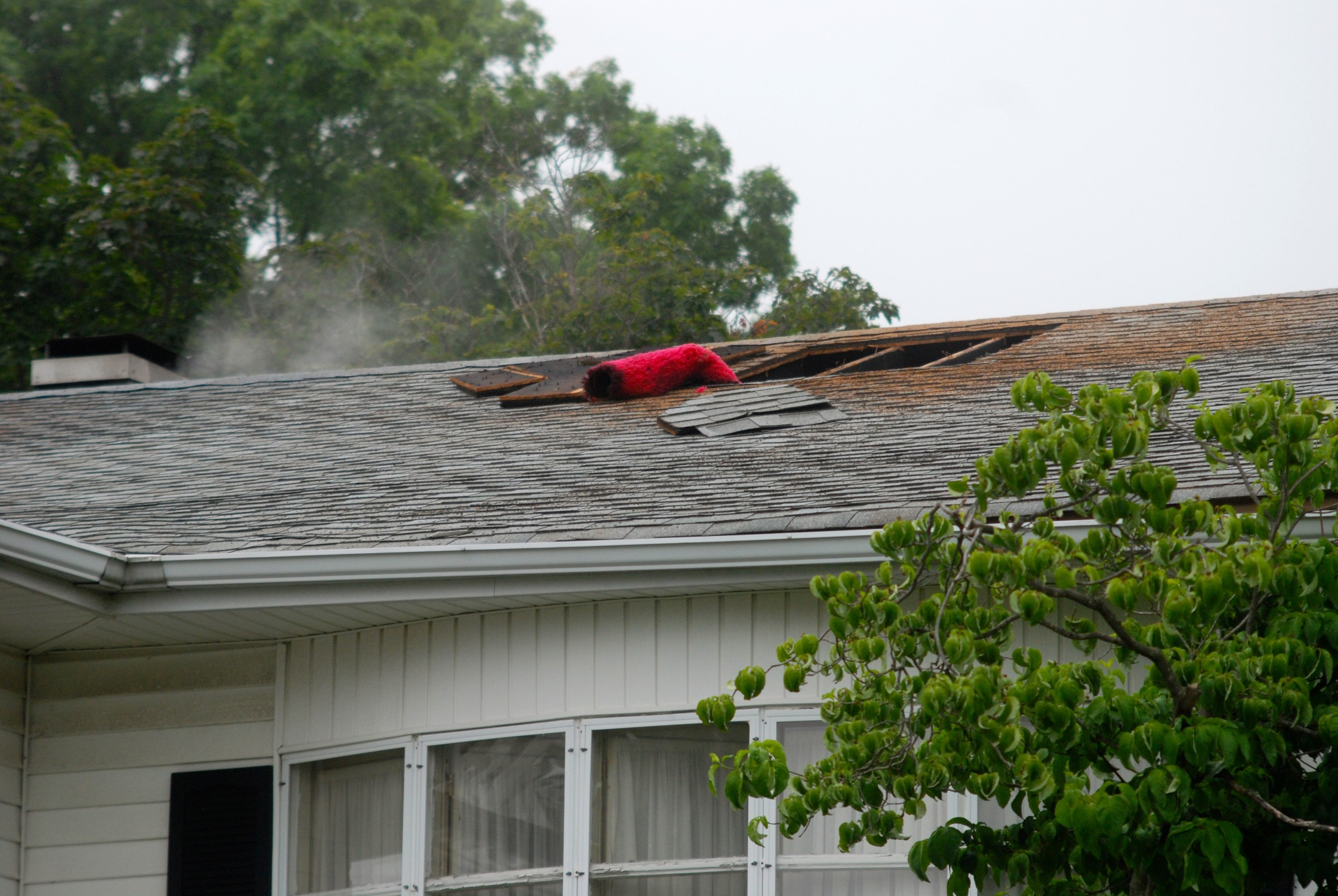 Firefighters cut through the roof to open a cavity where they could fight the fire.