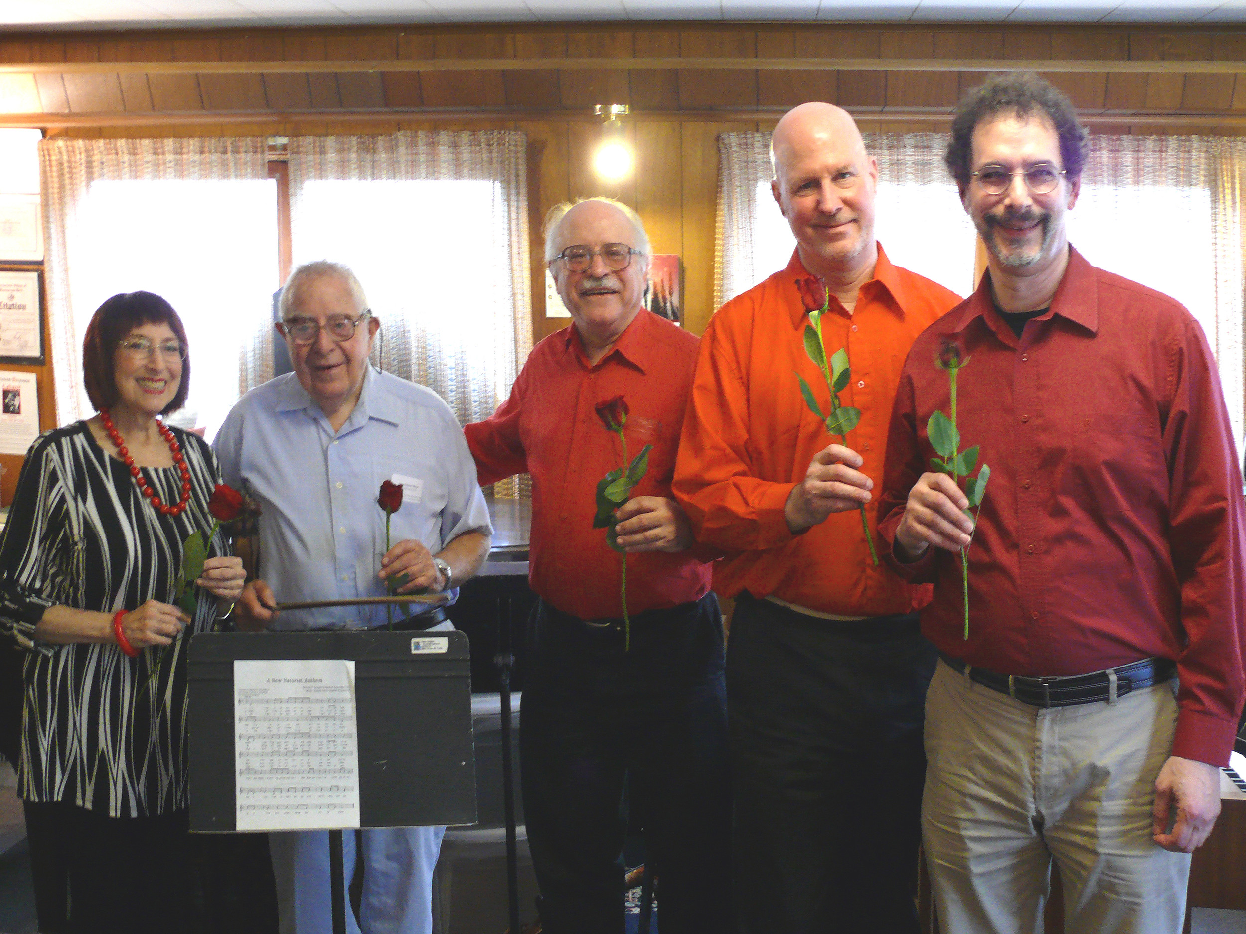 Roses were passed around after the concert performance Helene Williams, left, Nathaniel S. Lehrman, Leonard Lehrman, Kurt Behnke and Daniel Hyman.