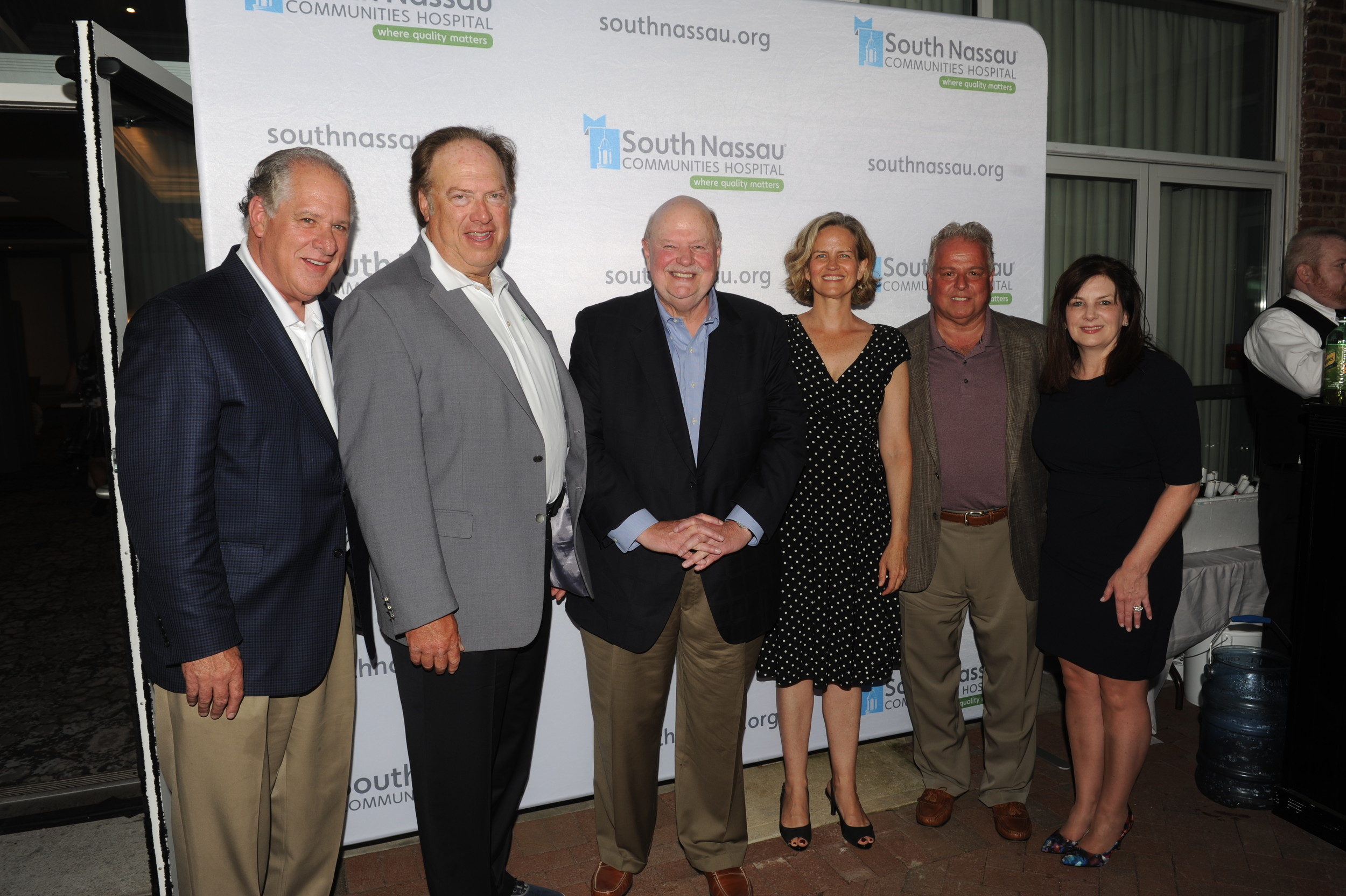 Golf Committee co-chairmen Tony Cancellieri and Jeff Greenfield, left, Chairman of the Board Joseph Fennessy, Legislator Laura Curran and Michael and Eileen Sapraicone.
