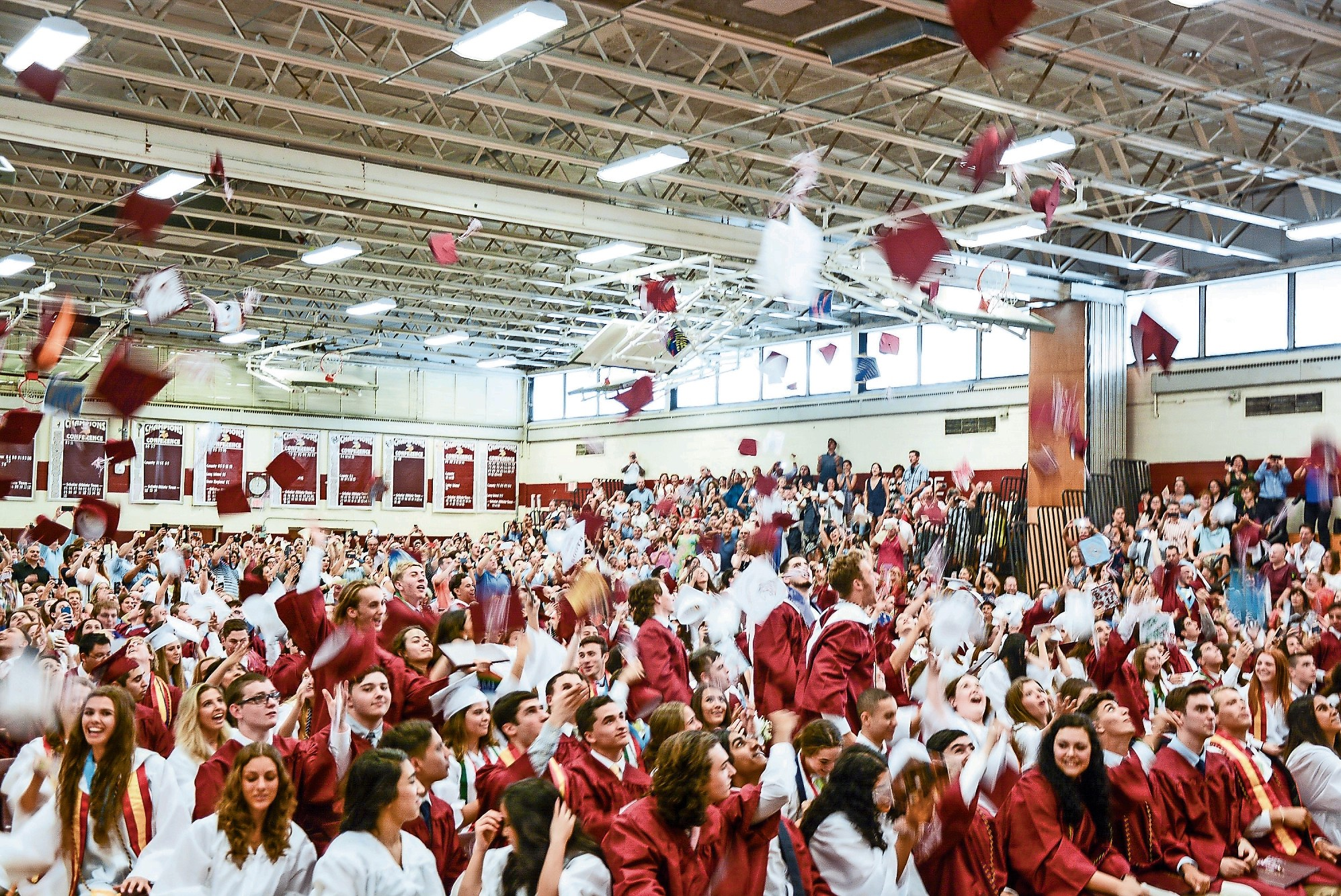 Mortarboards flew to the ceiling after Principal Albert Cousins shared his closing remarks at North Shore High School's graduation ceremony last Friday in the school gymnasium.