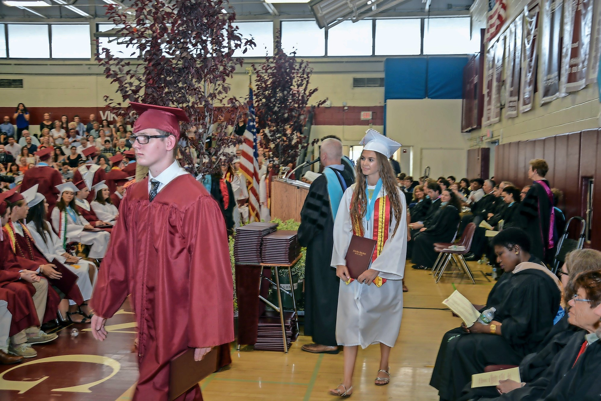 Students received diplomas from Principal Albert Cousins.