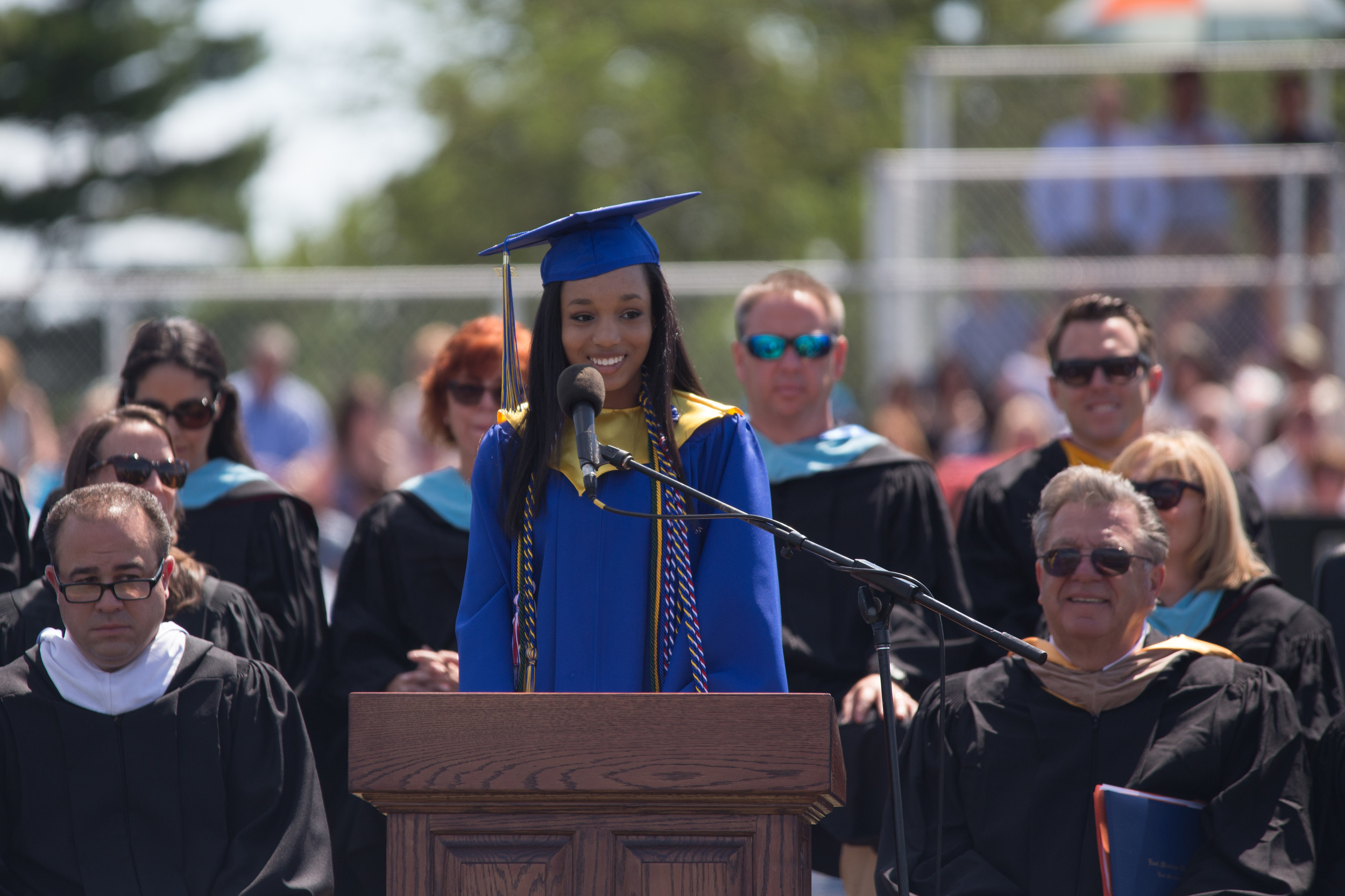As her peers cheered her on, East Meadow High School's valedictorian Mahalia Mathelier smiled at the crowd.