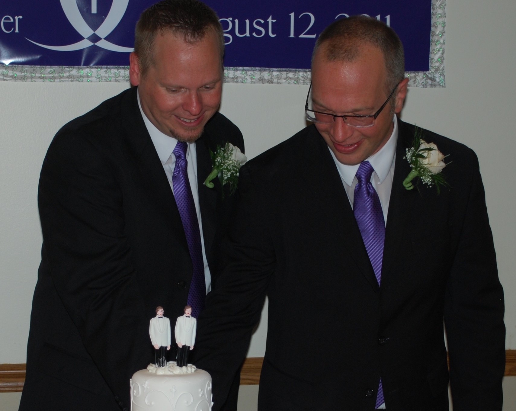 The Rev. Christopher Hofer, left, married Kerry Brady in August 2011 at the Church of St. Jude in Wantagh.