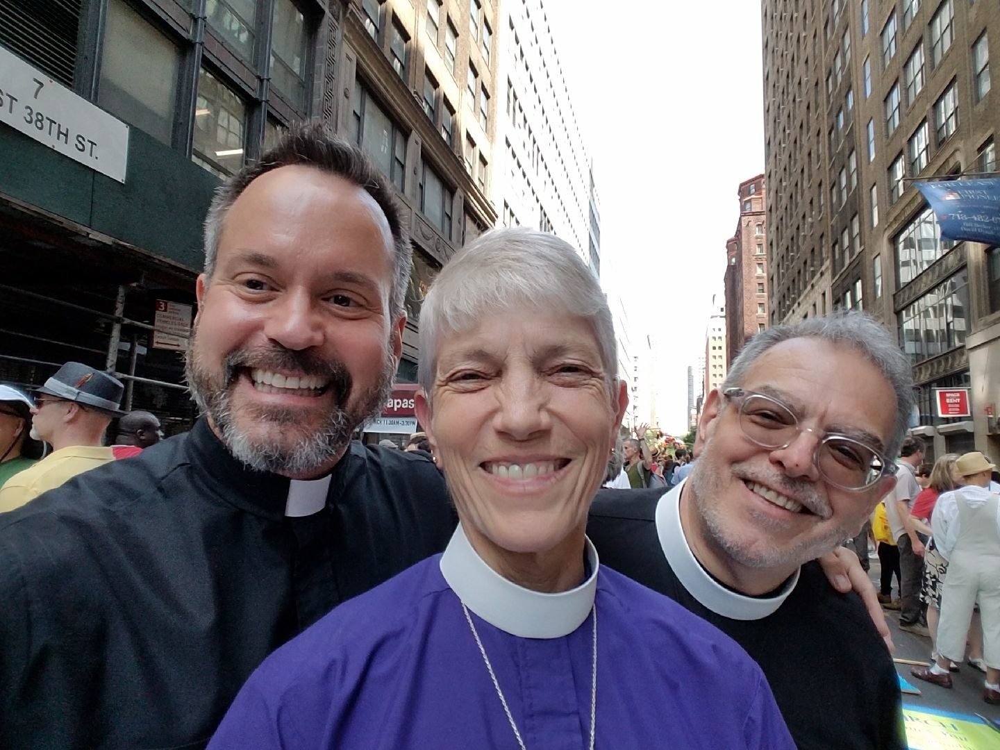 The Rev. J. Christopher Ballard, left, rector of Trinity-St. John's Church in Hewlett; the Right Rev. Mary D. Glasspool, assistant bishop of the Episcopal Diocese of New York; and the Rev. Michael Delaney, canon pastor of the Cathedral of the Incarnation in Garden City, attended the New York City Pride Parade last year.