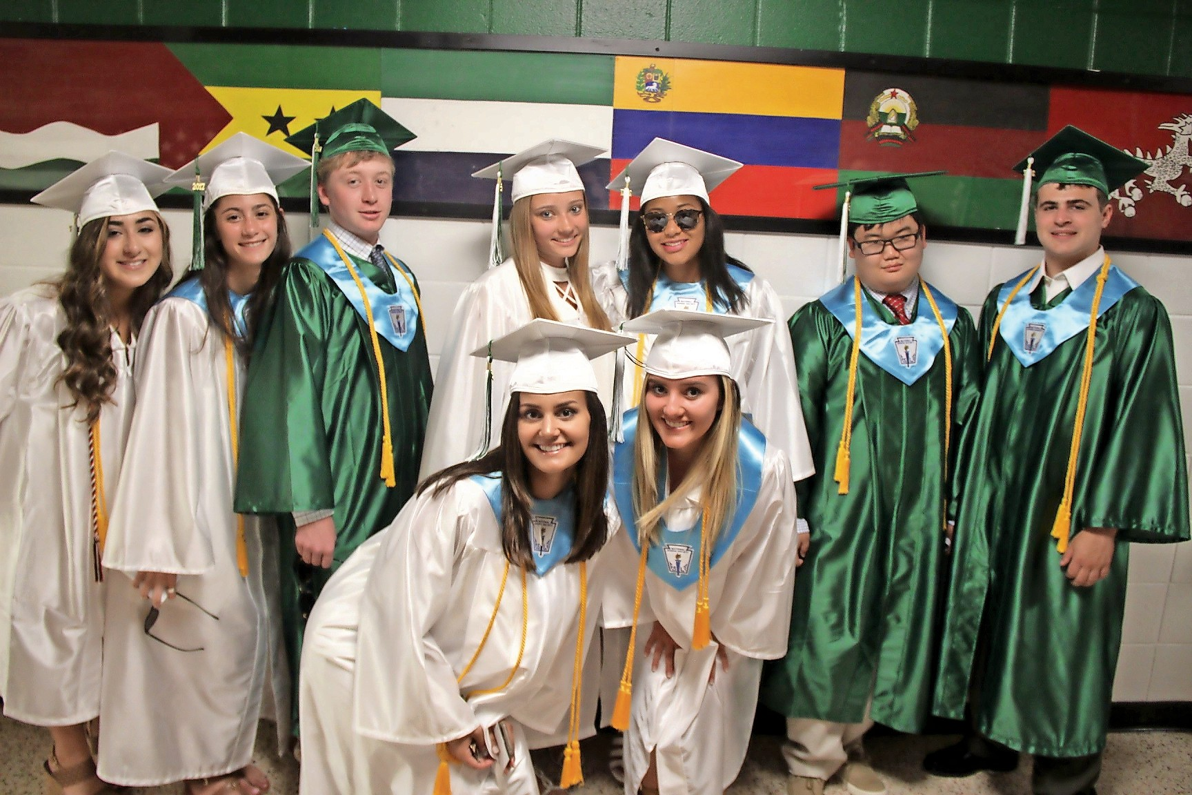 A group of very happy graduates from Locust Valley High School.