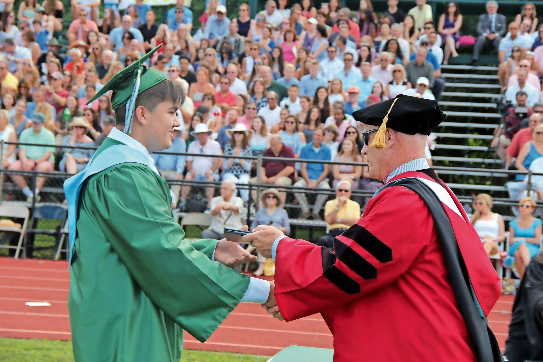It was a proud moment for Andre Cisneros when he accepted his diploma from Locust Valley High School Principal Dr. Kieran McGuire.