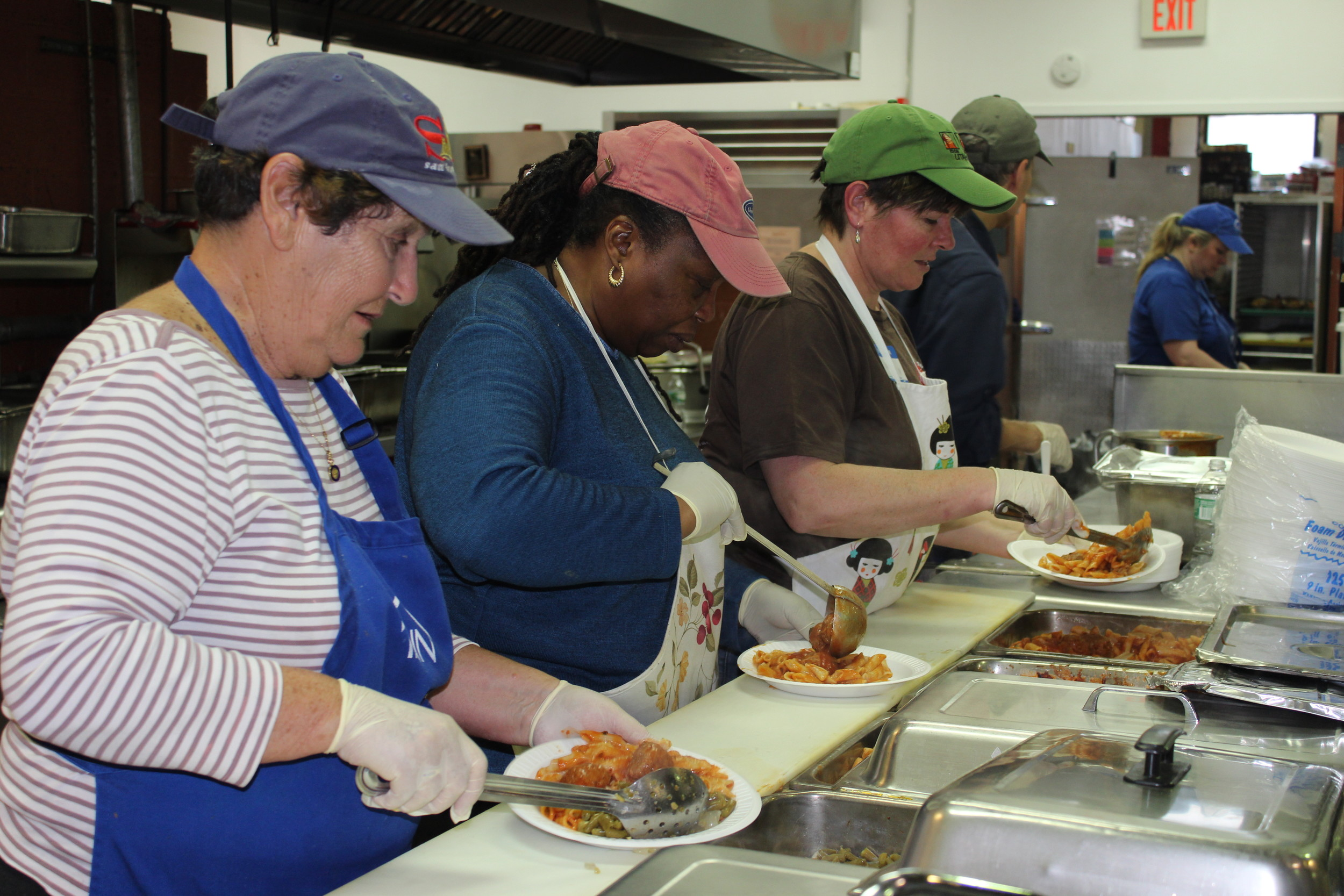 Volunteers at the INN's Mary Brennan Soup Kitchen, top, prepared meals for the homeless and hungry. The soup kitchen serves 300 people each weekday.