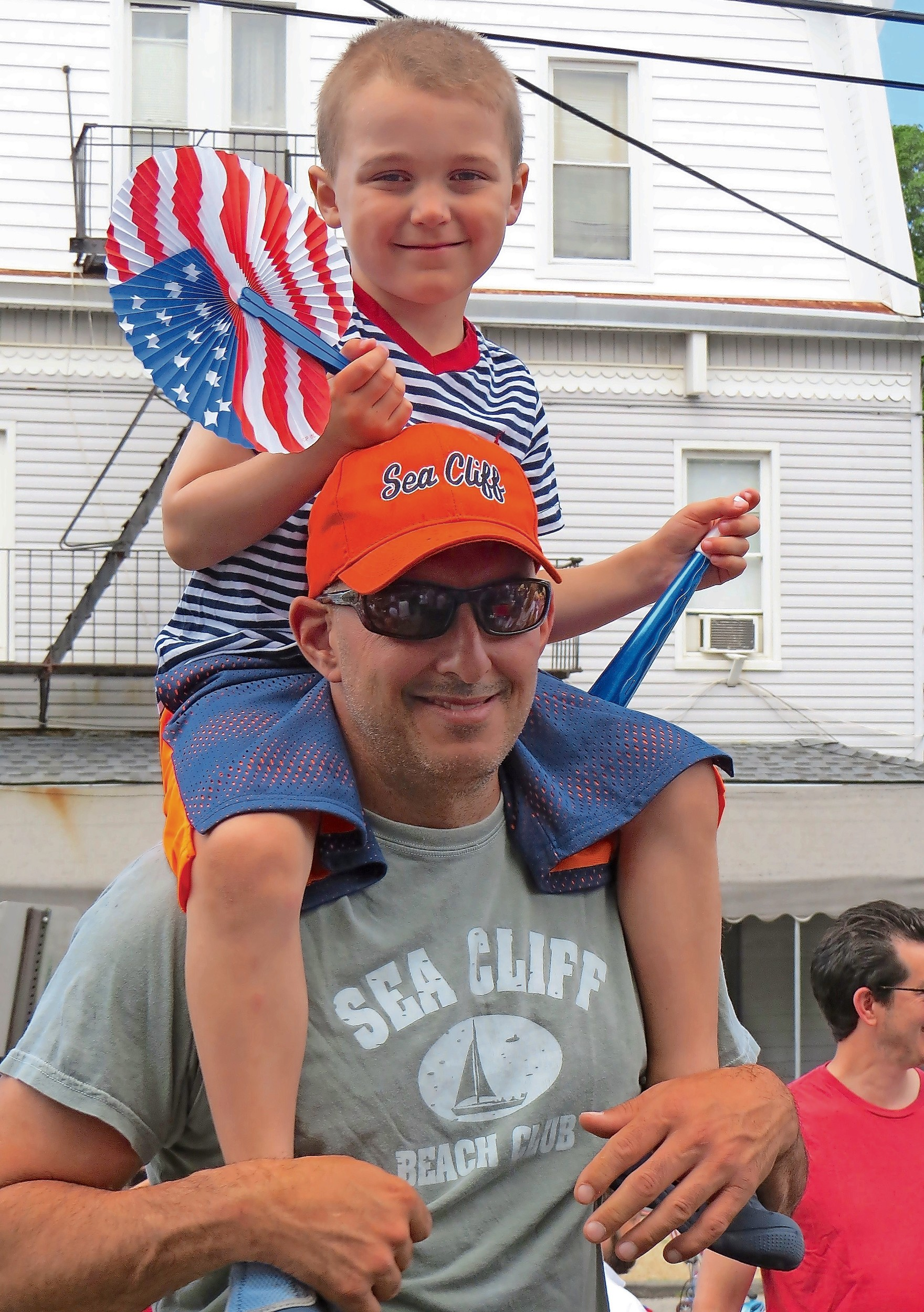 Dylan Capuano, 5, sat on his dad George's shoulders, to get a great view of all the festivities during the parade.