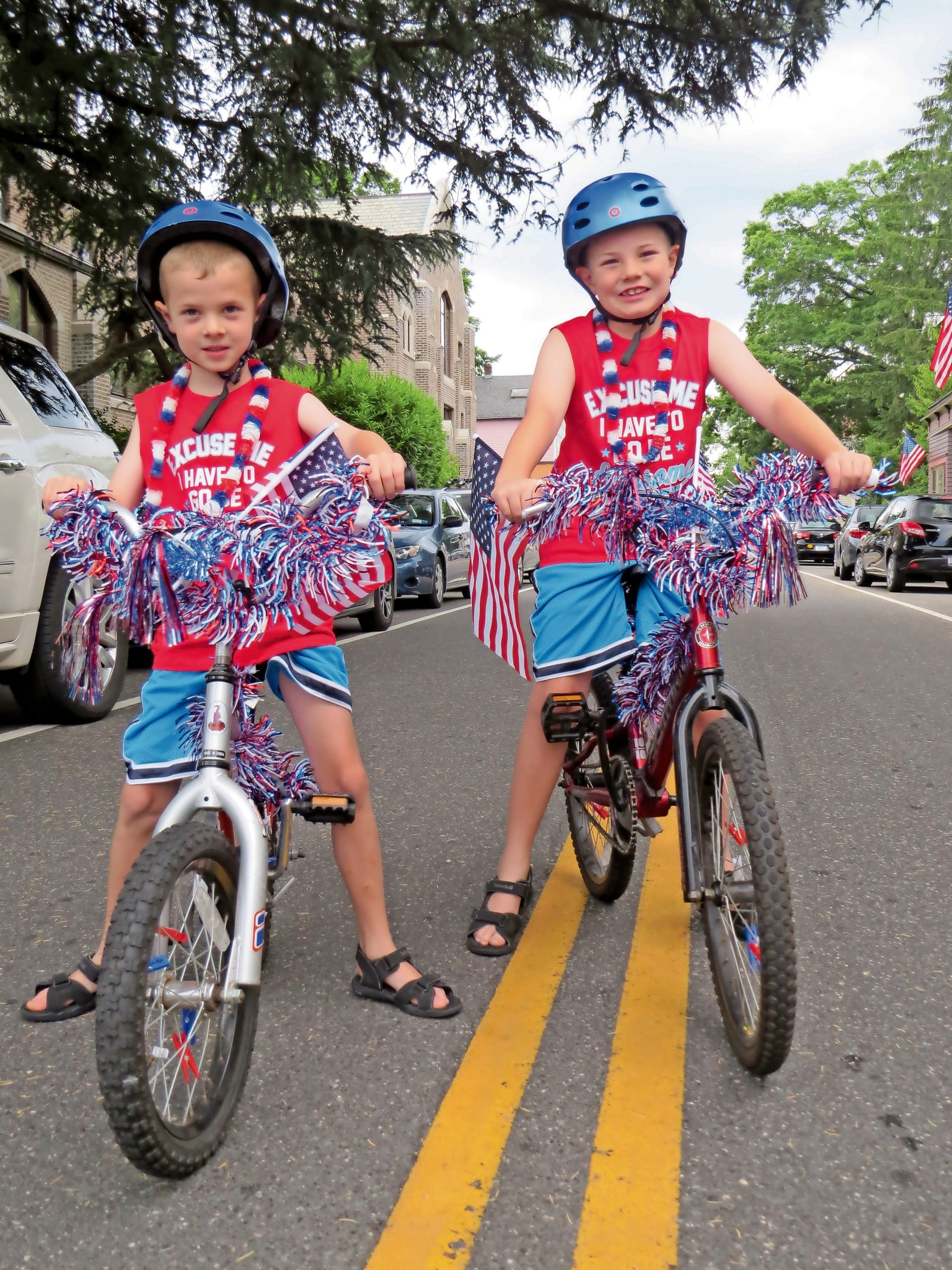 Cade, left, 6, and Ty Fichtl, 8, were decked out in the nation's colors to go along with their bicycles.