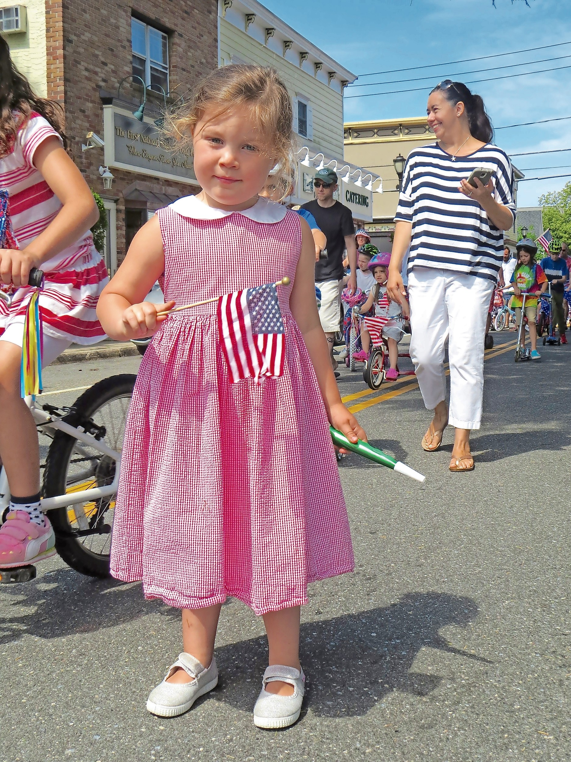 Ellamae Grau, 3, waved her flag as she marched in the parade.
