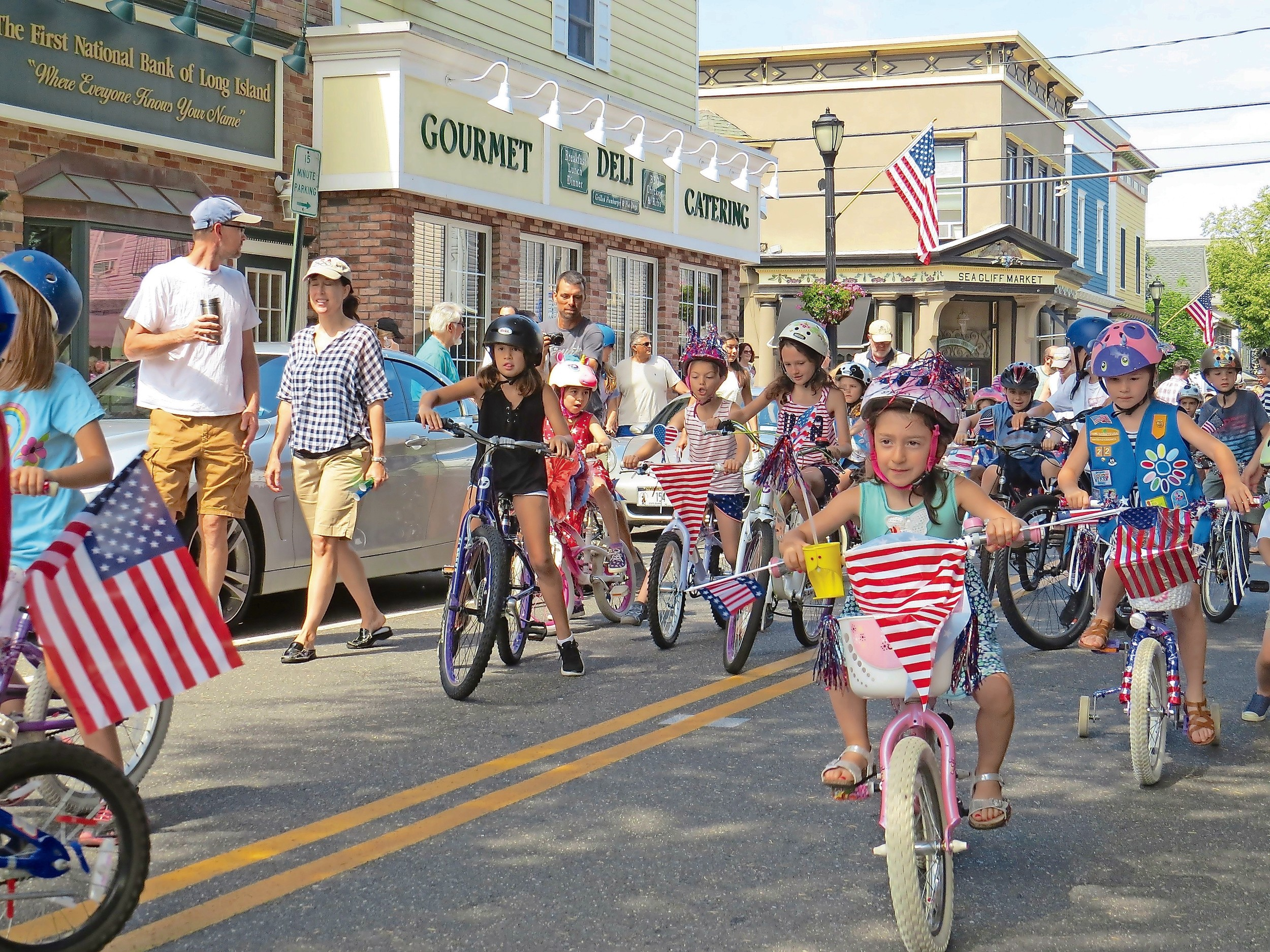 Residents marched down Sea Cliff Avenue as children rode their bikes in Sea Cliff's Fourth of July parade on Tuesday.