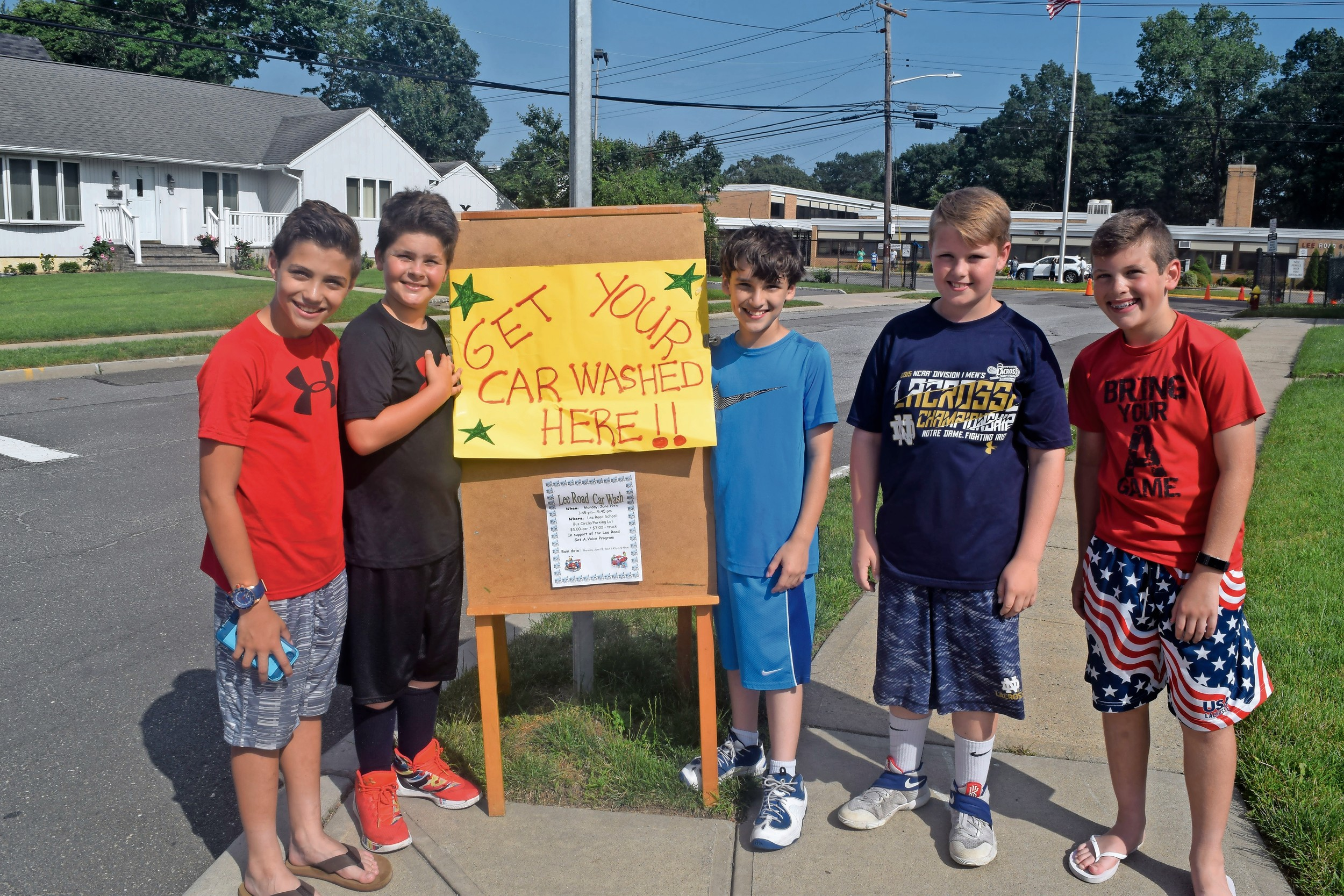 Fifth-graders Ralph Boccio, left Eric Sharp, Dylan Livigni, Ryan Sheehan and Ryan Muckle urged Wantagh, Seaford and Levittown residents to stop by the car wash.