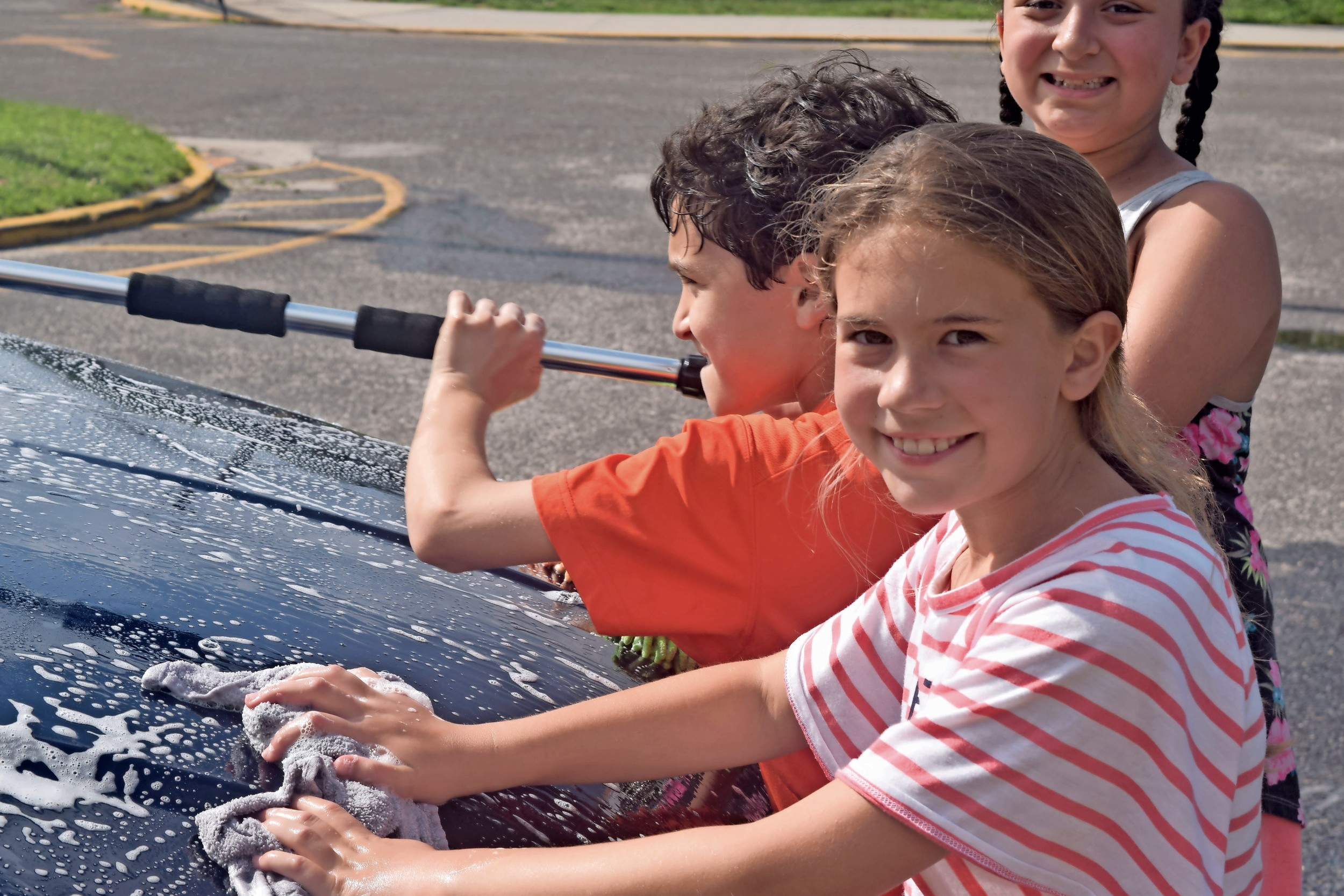 Haley Spinoso, a 10-year-old Wantagh resident, soaped up a car.