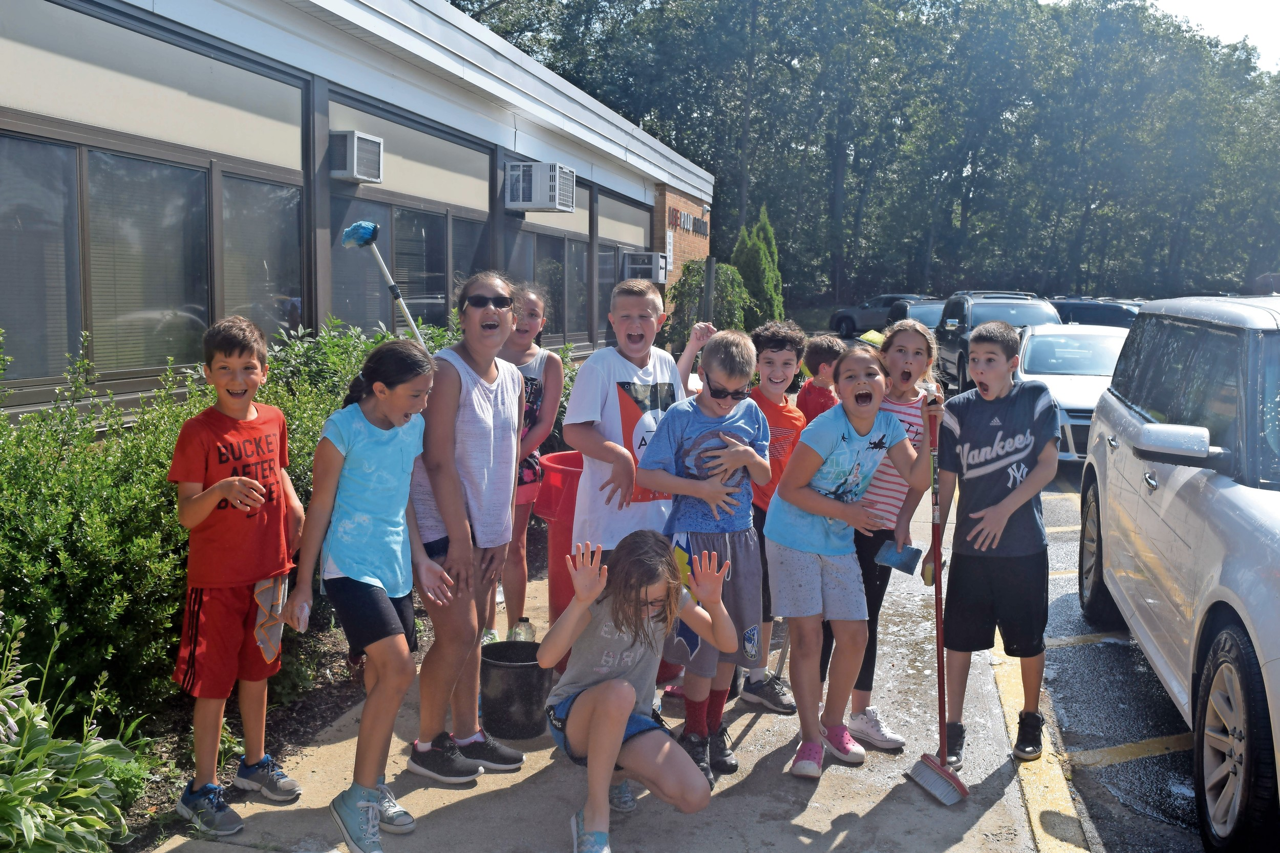Lee Road Elementary students had fun spraying each other with water at the end-of-the-year car wash — a fundraiser for the school's character education program — on June 19.