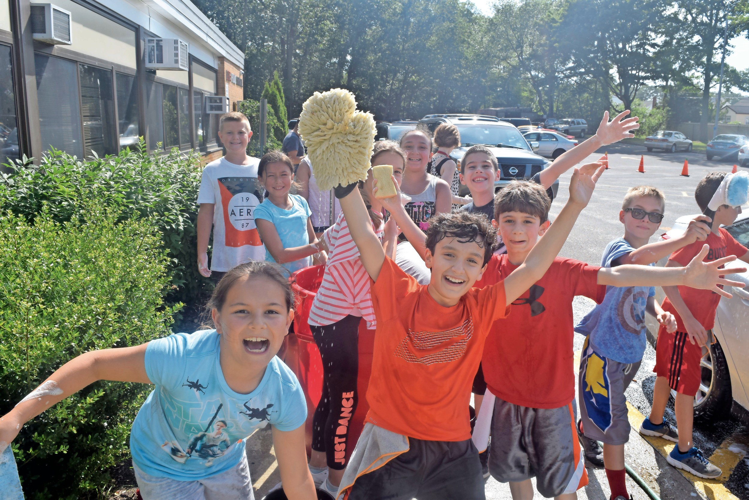 Lee Road Elementary students got super soapy at an end-of-the-year car wash — a fundraiser for the North Wantagh school's character education program — on June 19.