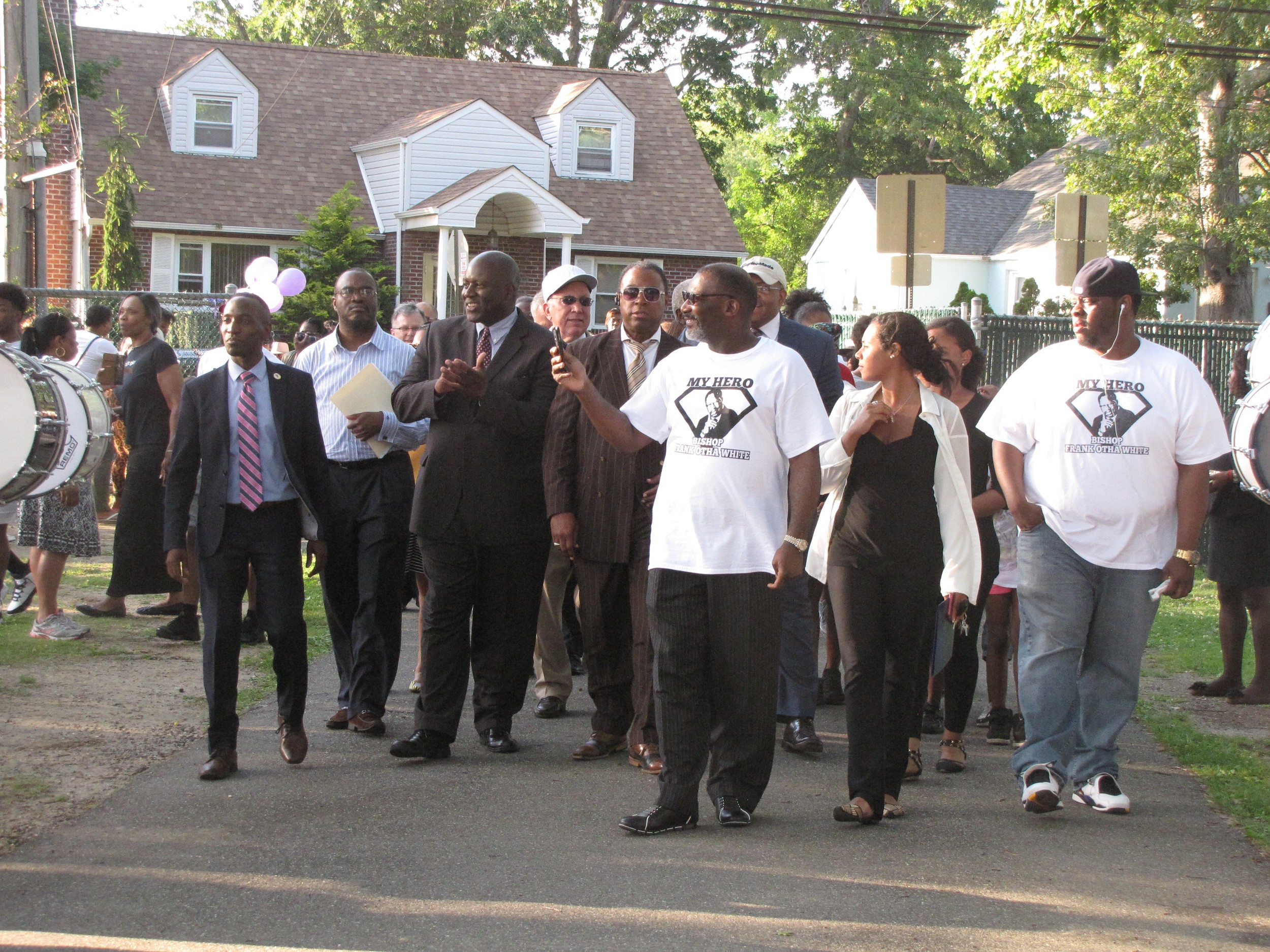 Freeport community leaders marched through the renamed Bishop Frank O. White Memorial Park.