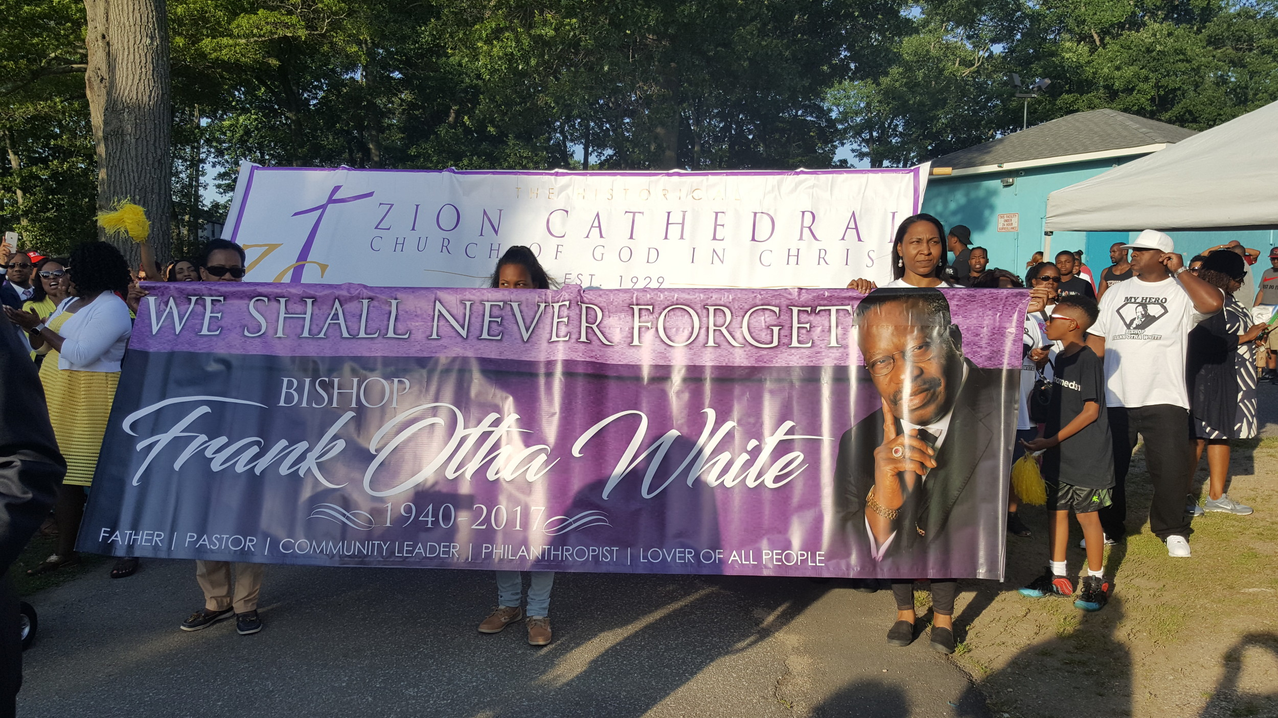 Members of the Zion Catherdral Church of God in Christ, along with members of the Cedarmore Corporation, waved multi-colored flags as they marched into the park on June 28.