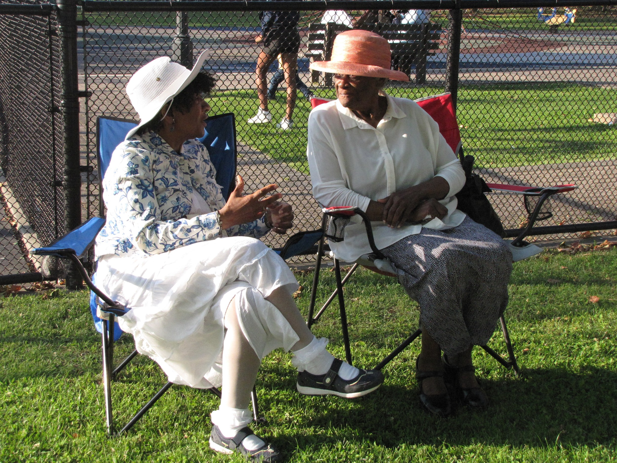 While they waited for the ceremony honoring Bishop White, two Freeport women chatted.