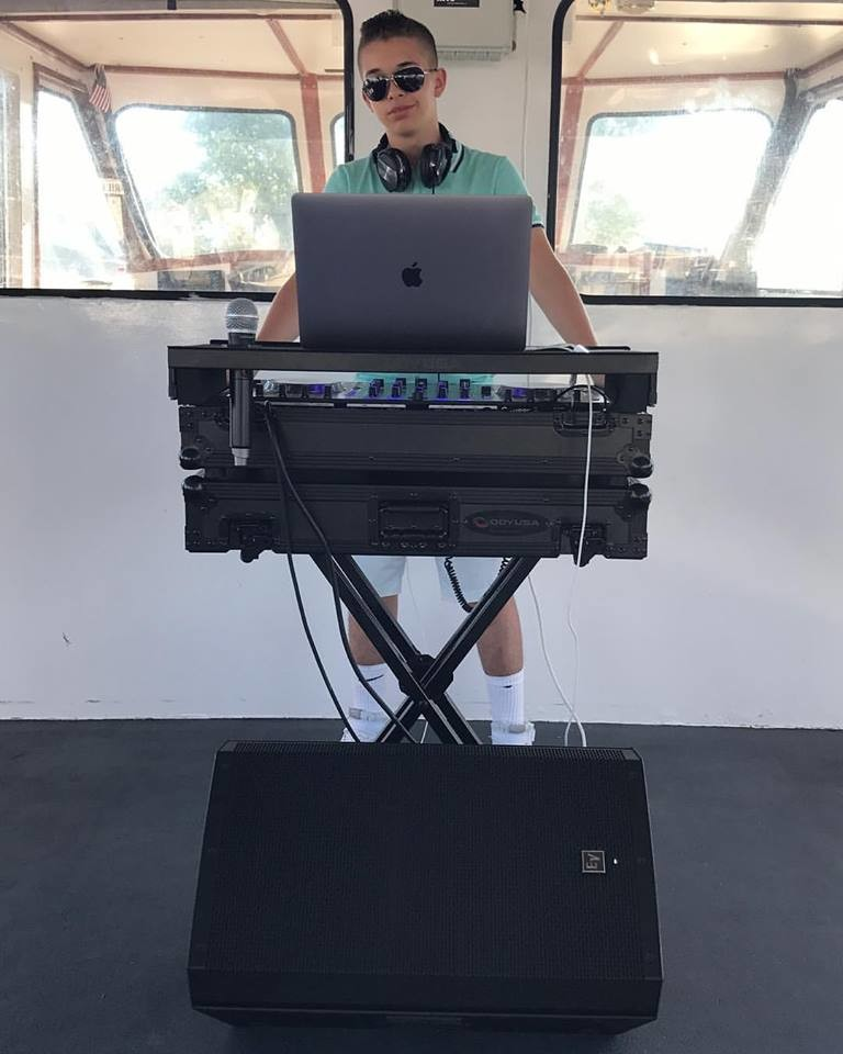 Oliver dropping beats for a party boat in Freeport's Nautical Mile