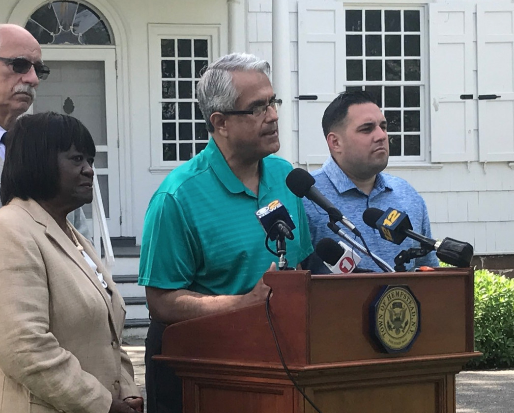 Town Supervisor Anthony Santino, center, announced legislation banning short-term rentals during a press event last month.