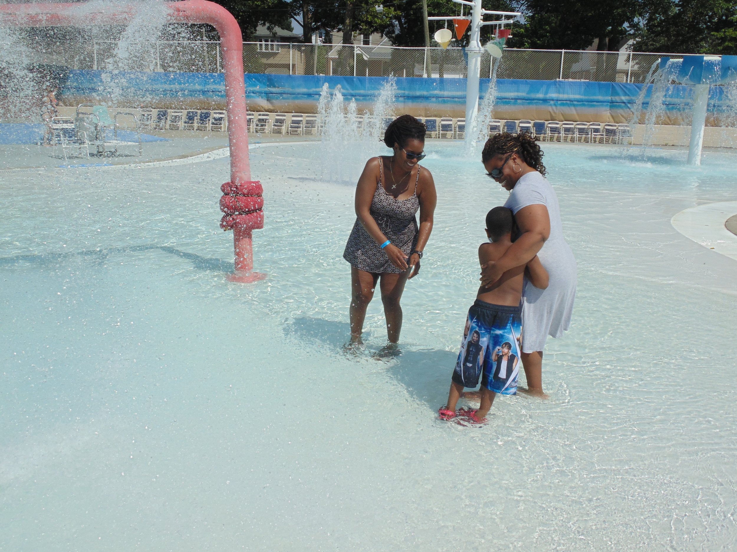 Dana Harden-Butts, right, brought her son into the interactive pool.