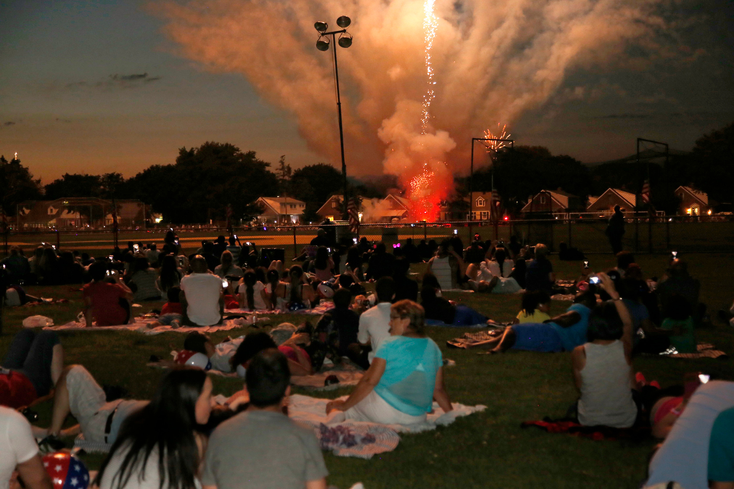 The crowd inside Fireman's Memorial Field in Valley stream got comfortable as the fireworks begin.