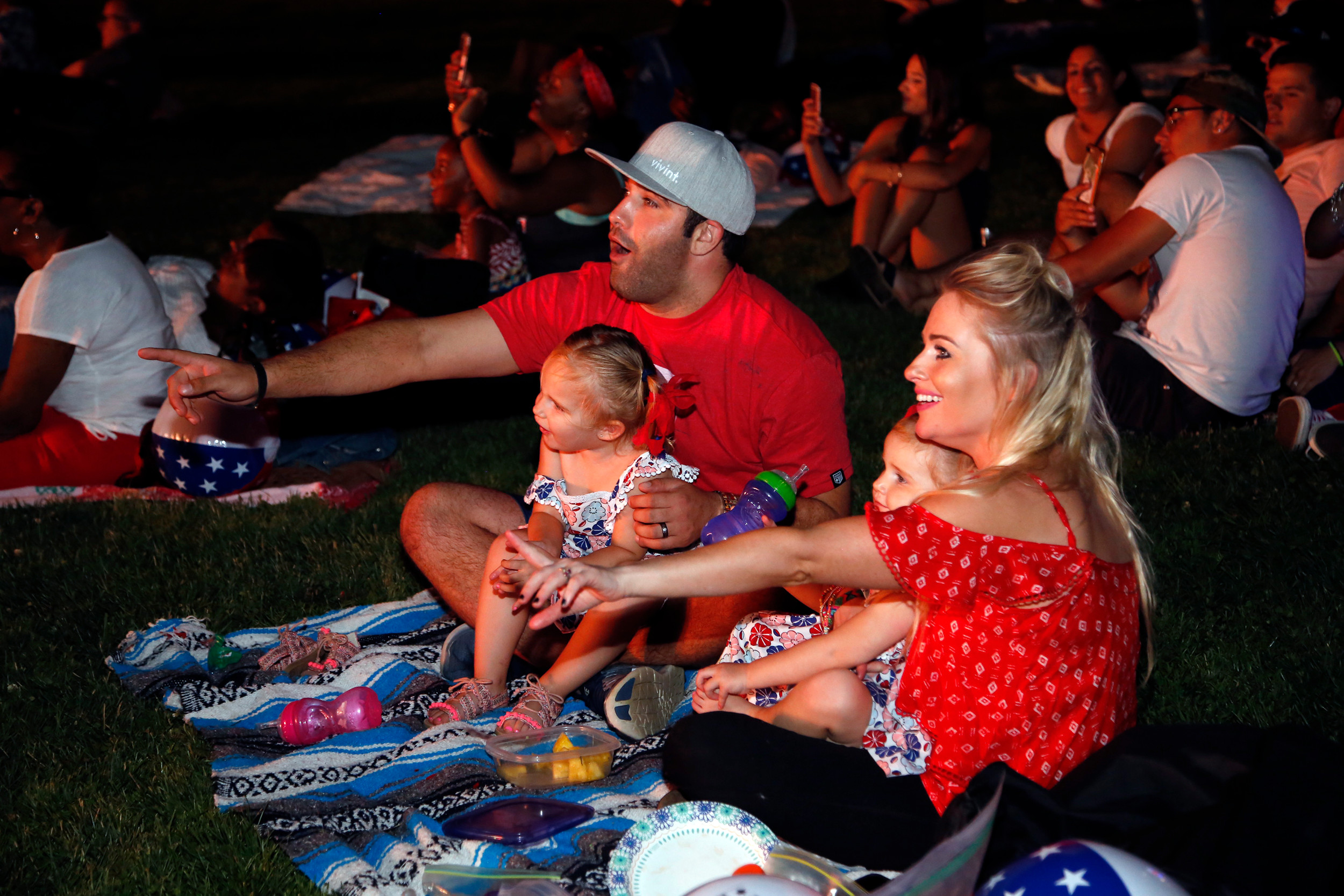 The Welch family watched as the fireworks show begins.