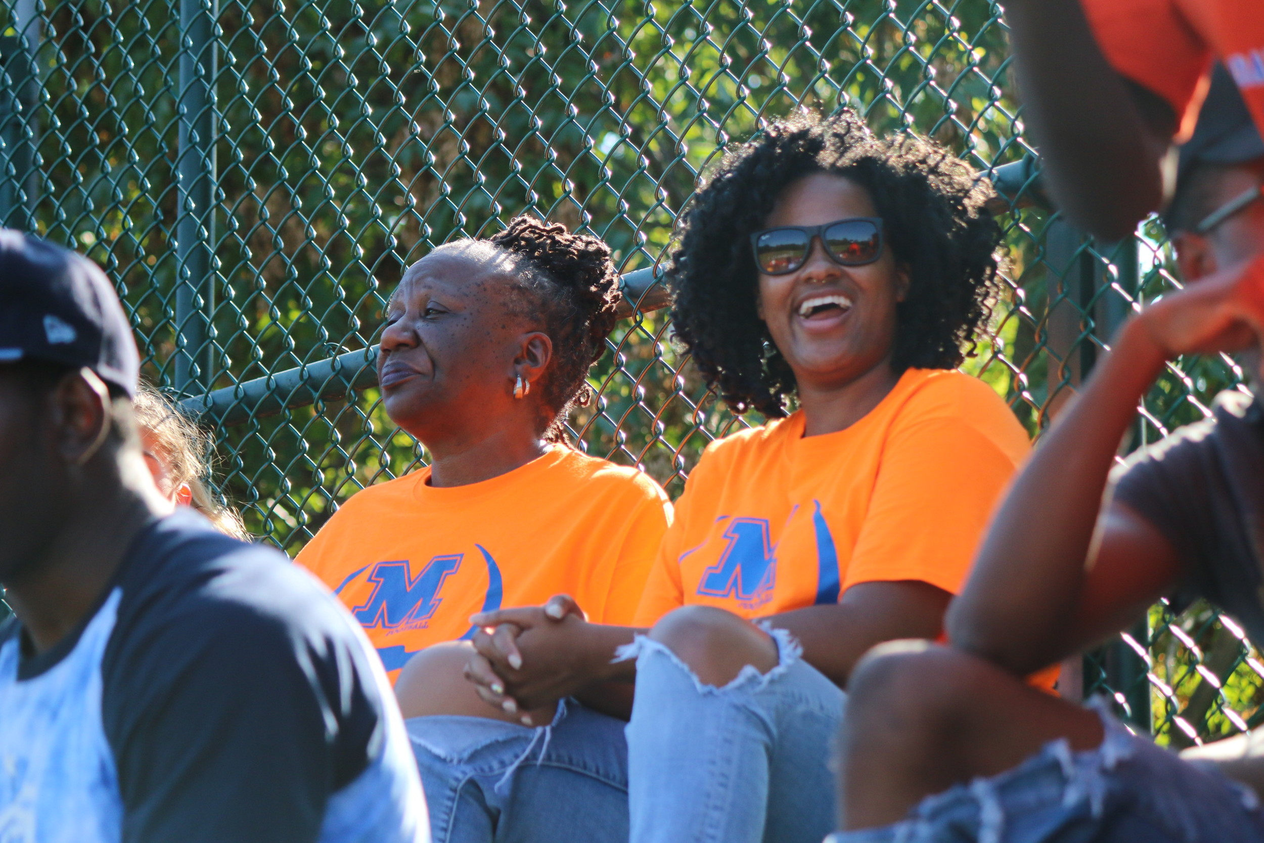 Norma Britt, left, and her daughter Alma Britt, at a Malverne High School football game last September.