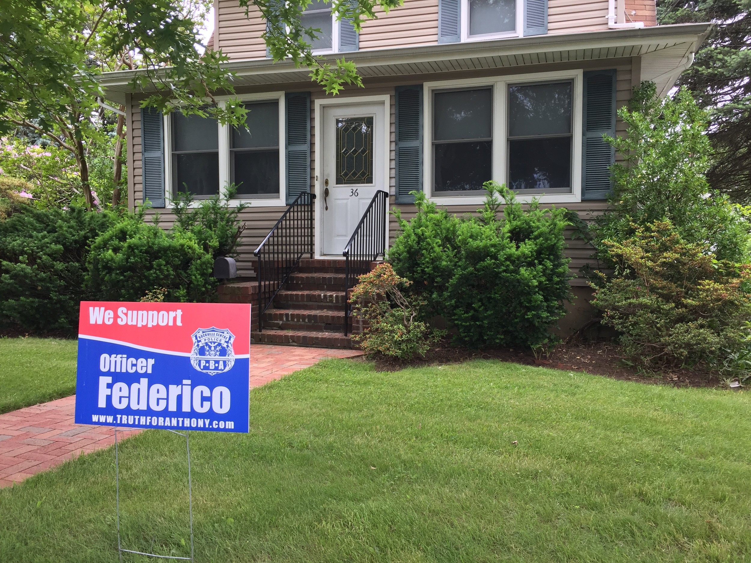 Lawn signs showing support for Officer Anthony Federico are in yards throughout the village and in surrounding communities.