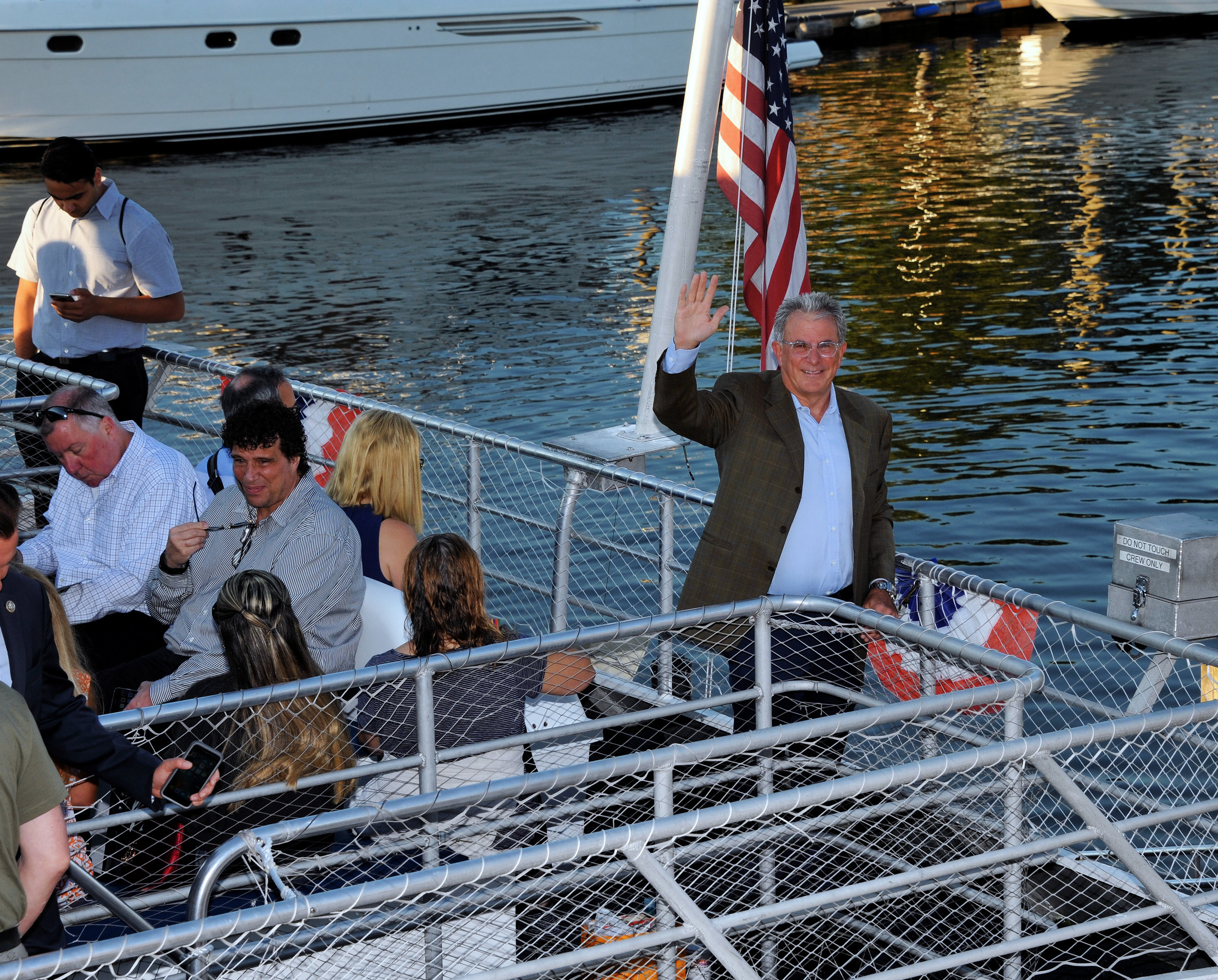 Peter Wagner, Financial Advisor of Oppenheimer waves as the second ferry departs Glen Cove.