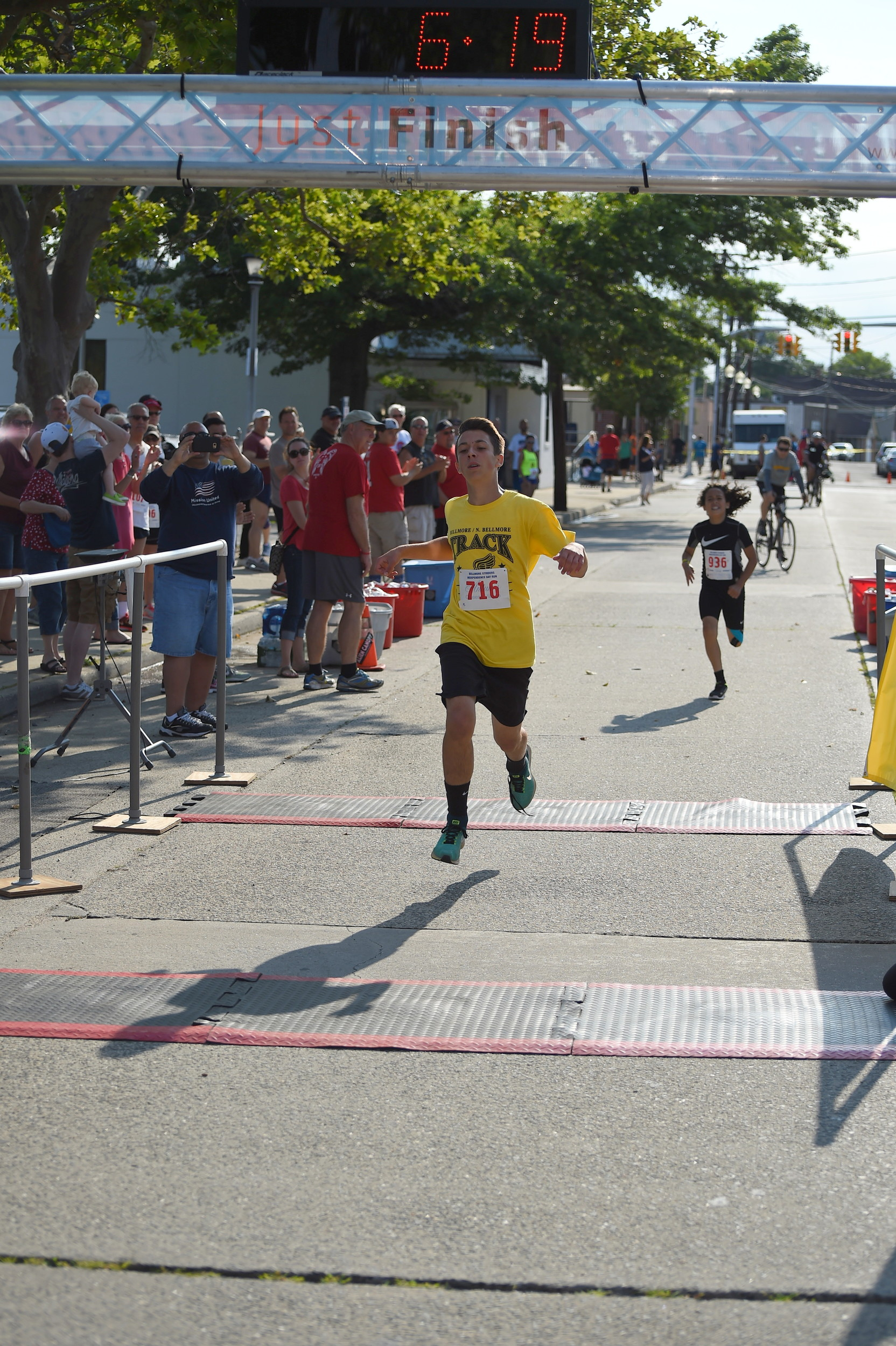 Anthony Scotto, 13, of North Bellmore, crossed the finish line in the one-mile race.