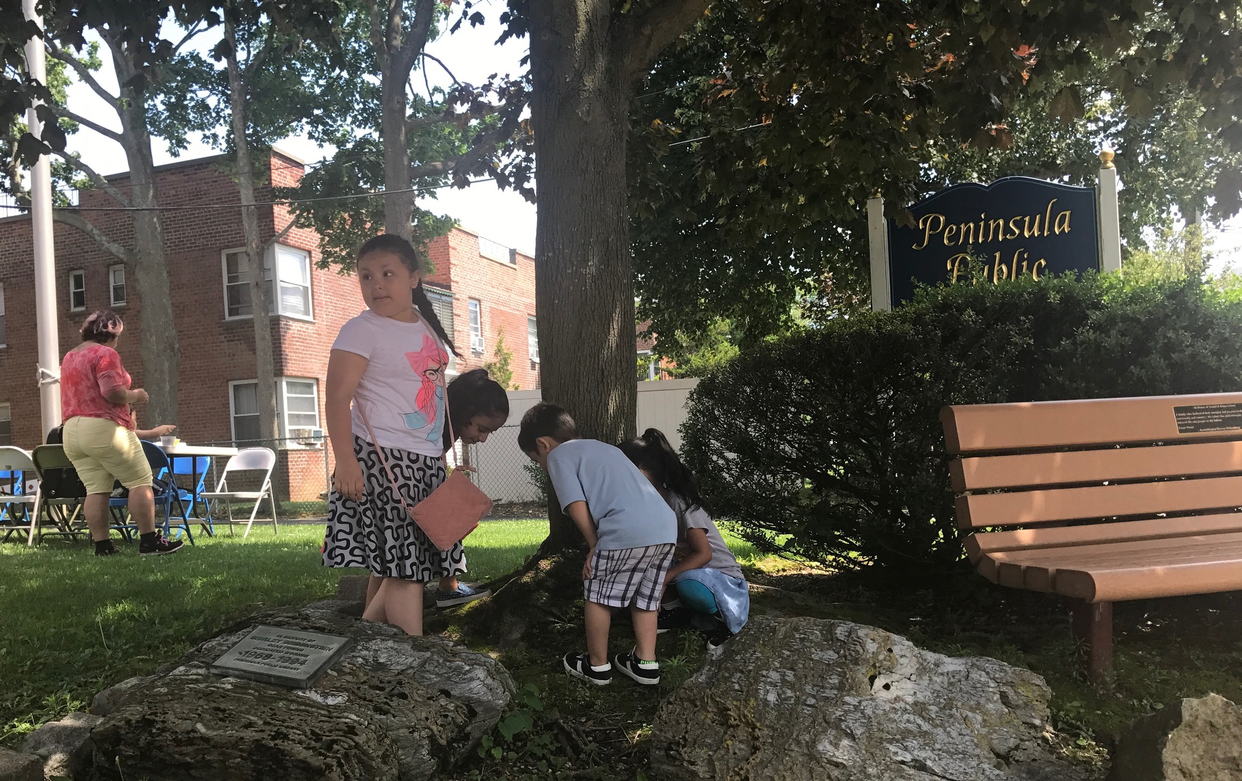 After eating, children watched as a worm crawled across a tree.