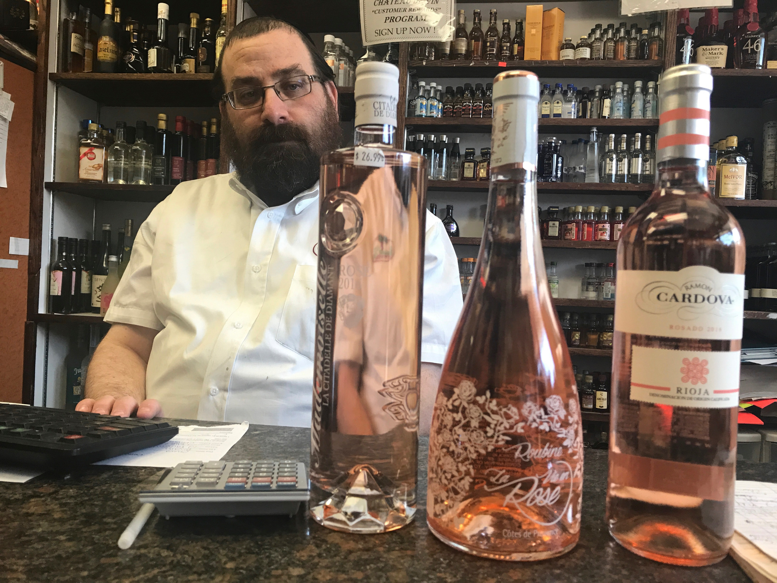 At Chateau De Vin  in Cedarhurst, Moshe Fink showed with three popular brands of Rosé, from left, Mademoiselle – La Citadelle de Diamant, Chateau Roubine: La Vie en Rose and Ramon Cardova Rosado.