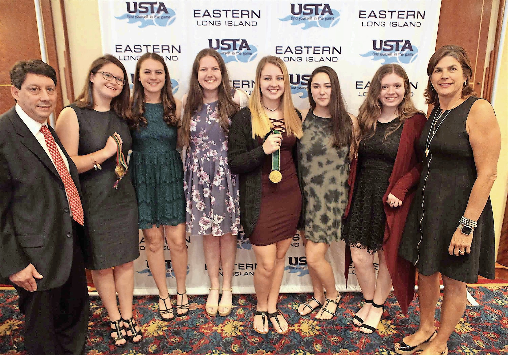 The MacArthur girls' tennis squad was named the High School Team of the Year at the U.S. Tennis Association Long Island Region Awards. Members of the team met with USTA Long Island President Jonathan Klee, far left, and International Tennis Hall of Fame member Gigi Fernandez, right, at the May 3 ceremony.