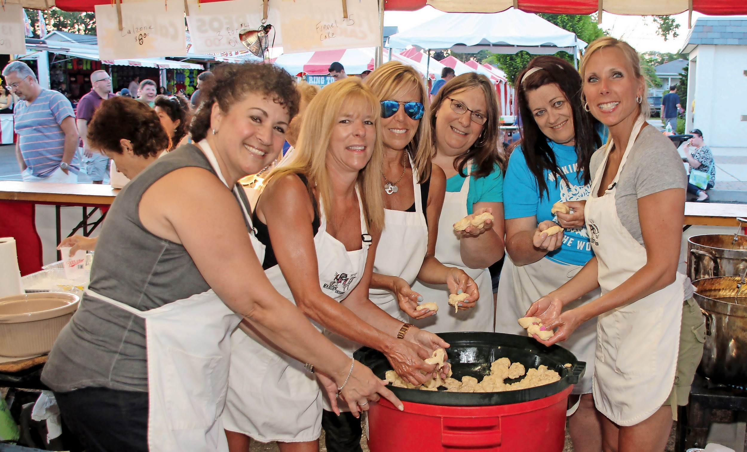 Fran Zinerco, left, Justine Silvestri, Joanne DeMichael, Maria Bongiovi, Janine Zacchino and Terry Nacci made zeppoles from scratch.