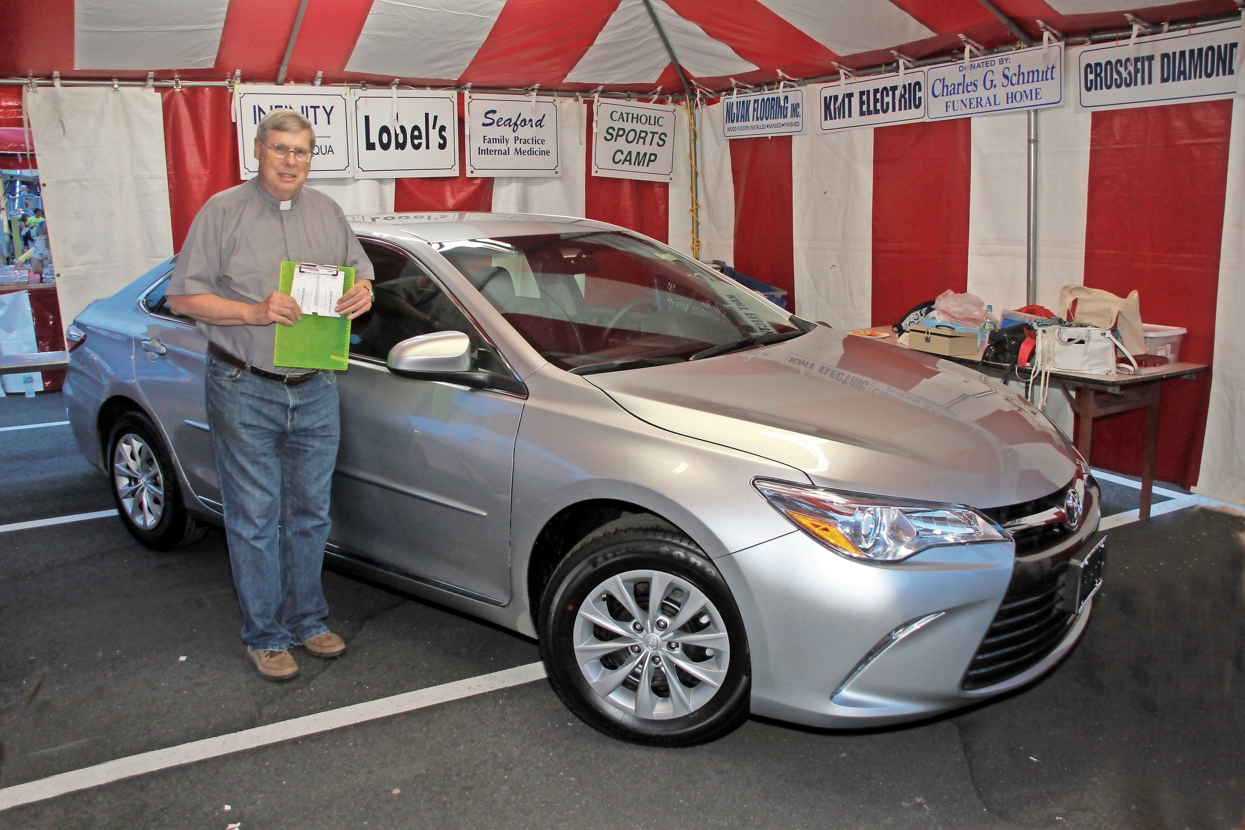 The Rev. Robert Hayden, pastor of St William the Abbot, showed fairgoers the raffle drawing grand prize: a 2017 Toyota Camry.