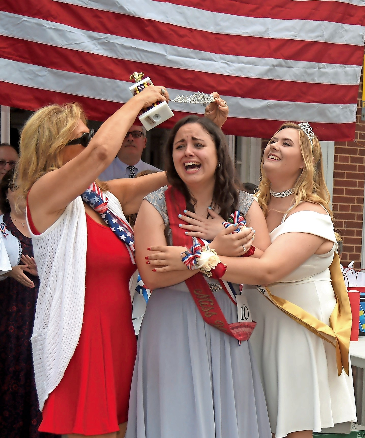 Samantha Walsh was crowned Miss Wantagh at Wantagh Elementary School on July 4. Former Miss Wantagh Emma Carey, right, and Director Ella Stevens embraced her.