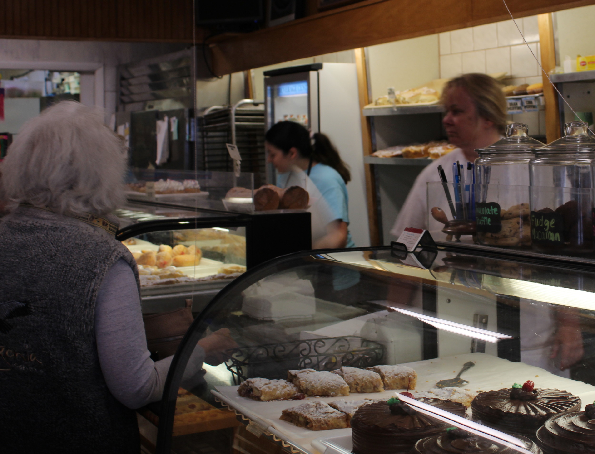 Debbie Entenmann, far right, tends to customers during the morning breakfast traffic at her family bakery.