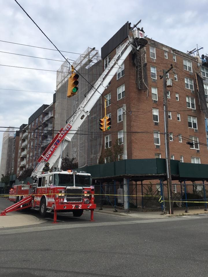 Firefighters worked to take down the dangling scaffolding and clear the area for potential falling bricks.