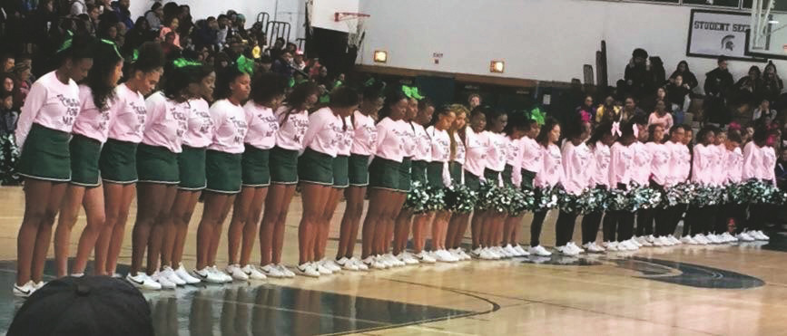 In Costanzo's memory, the Elmont cheerleading squad she coached wore special T-shirts at a pep rally.